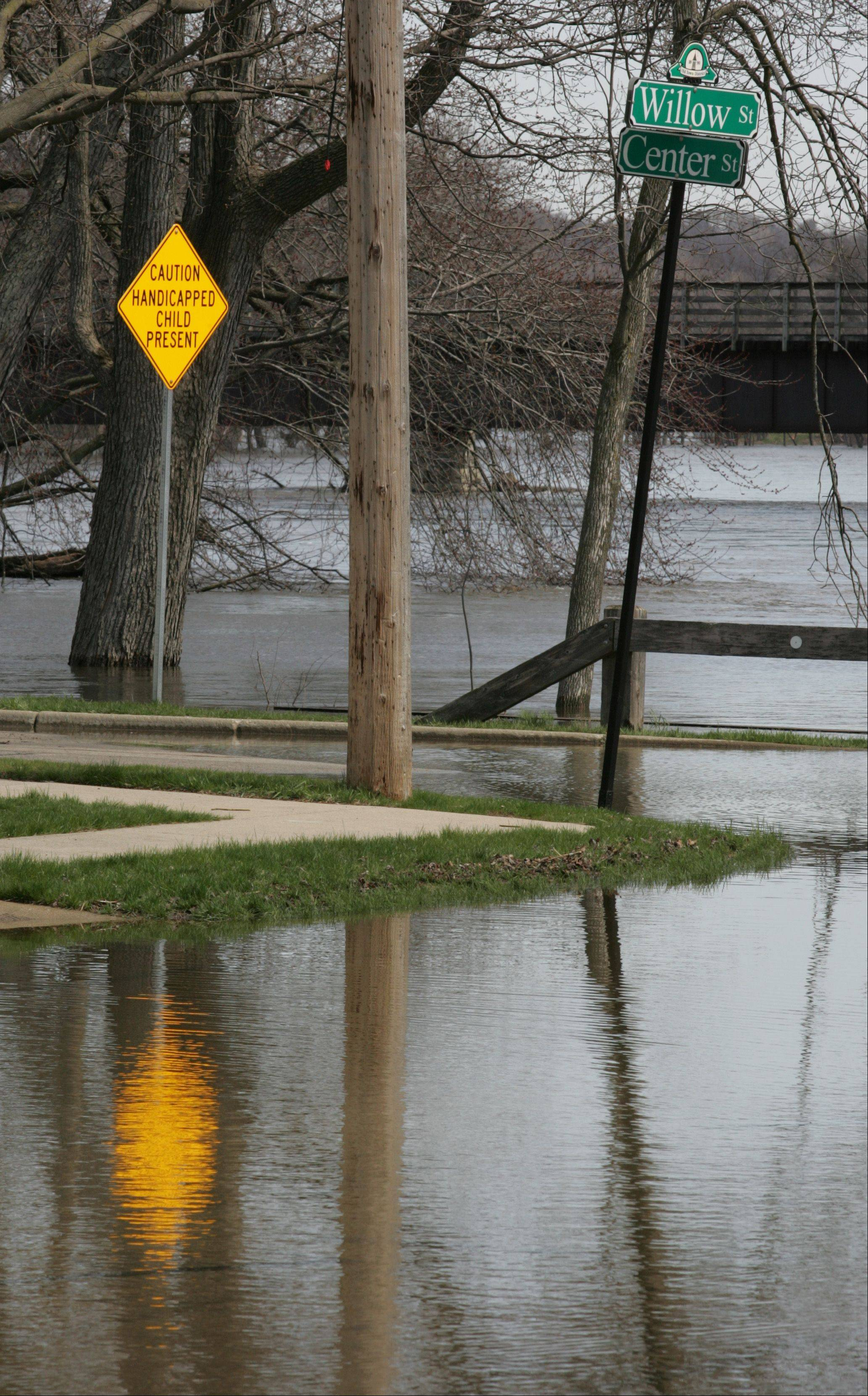 The corner of Willow and Center Streets in Algonquin has become part of the Fox River as floodwaters breech the banks of the river.