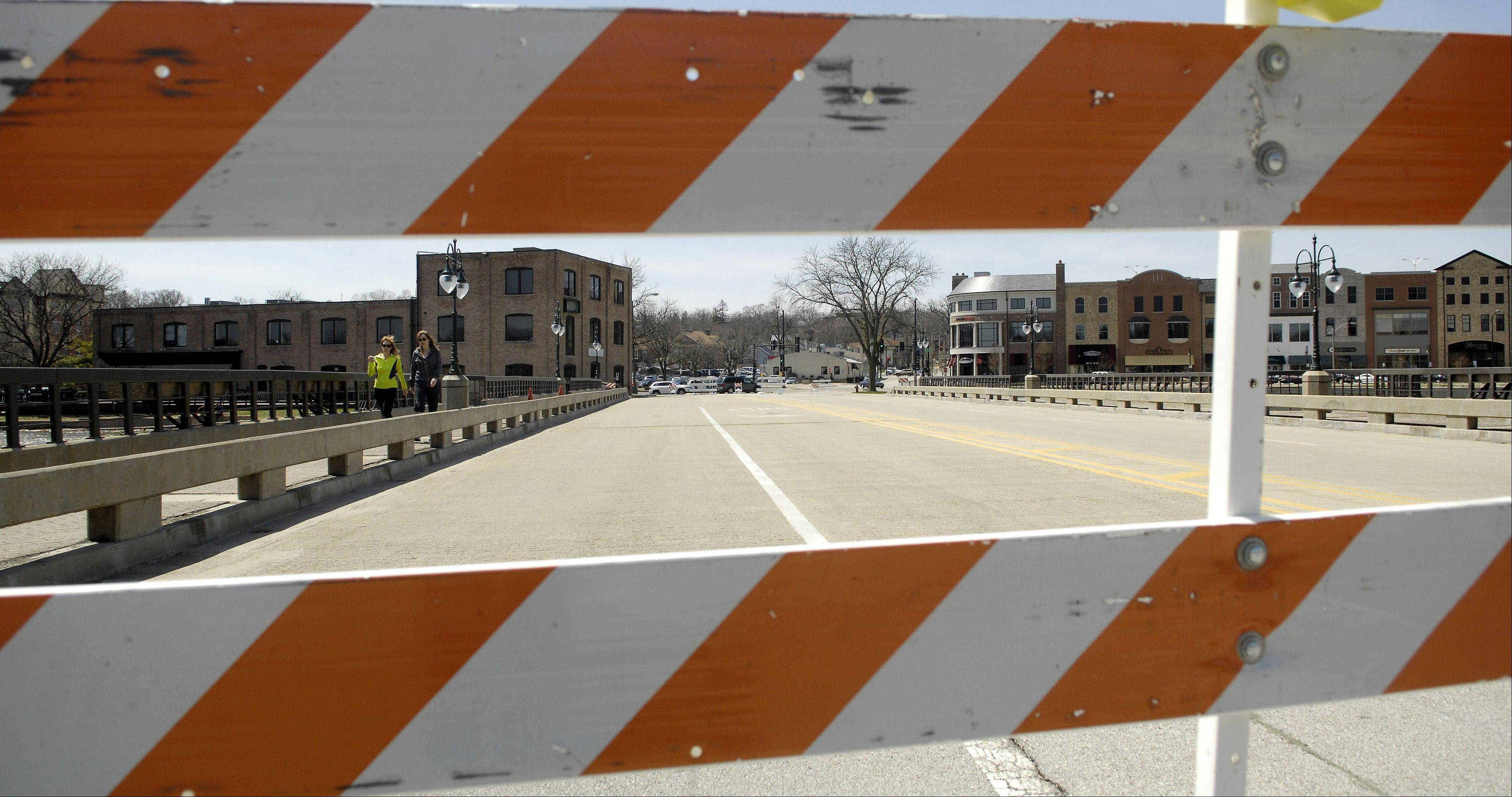 The Illinois Street bridge in St. Charles remains closed to vehicle traffic Monday due to the high level of the Fox River.