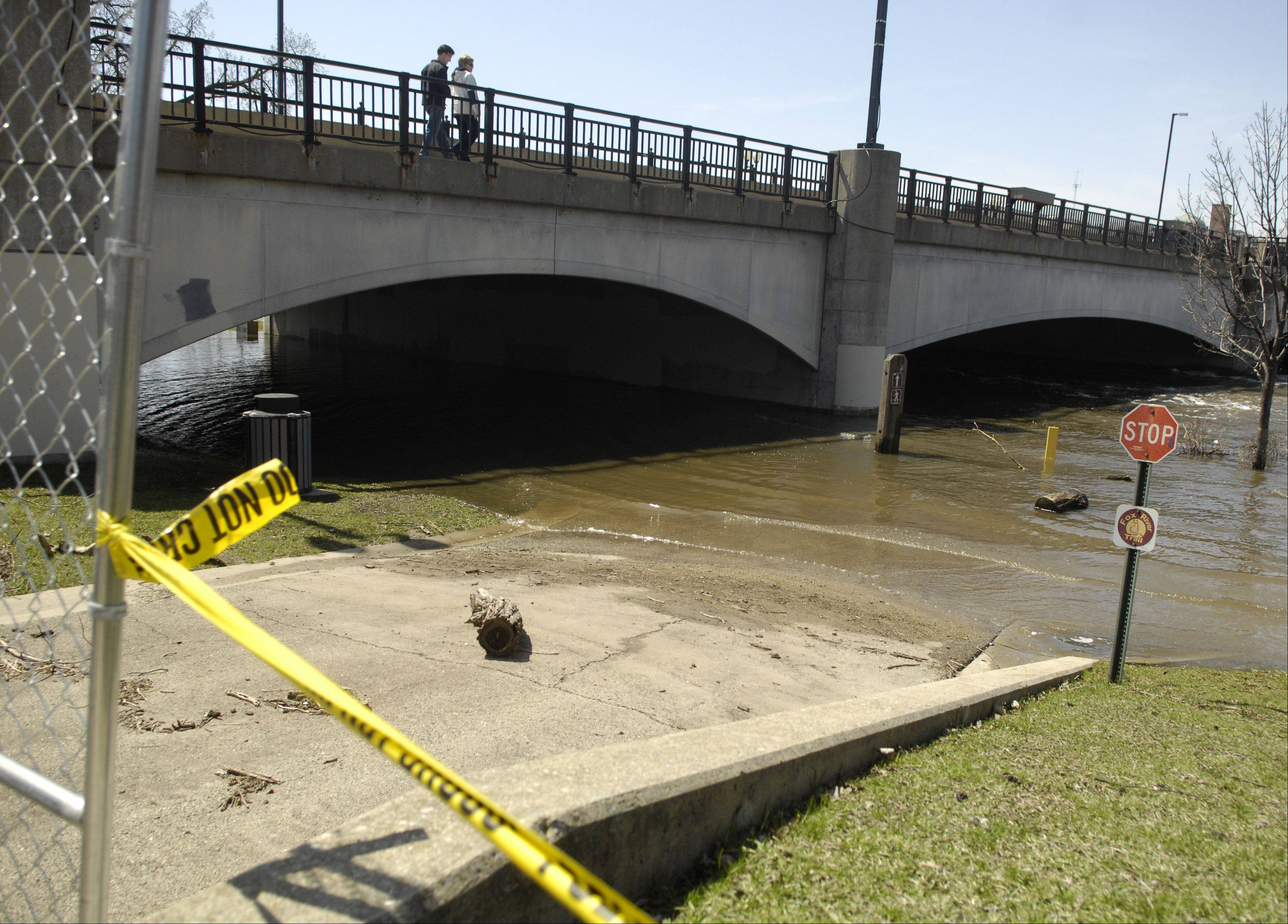 The northern entrance to Island Park in Geneva is blocked off Monday as the Fox River remained high.
