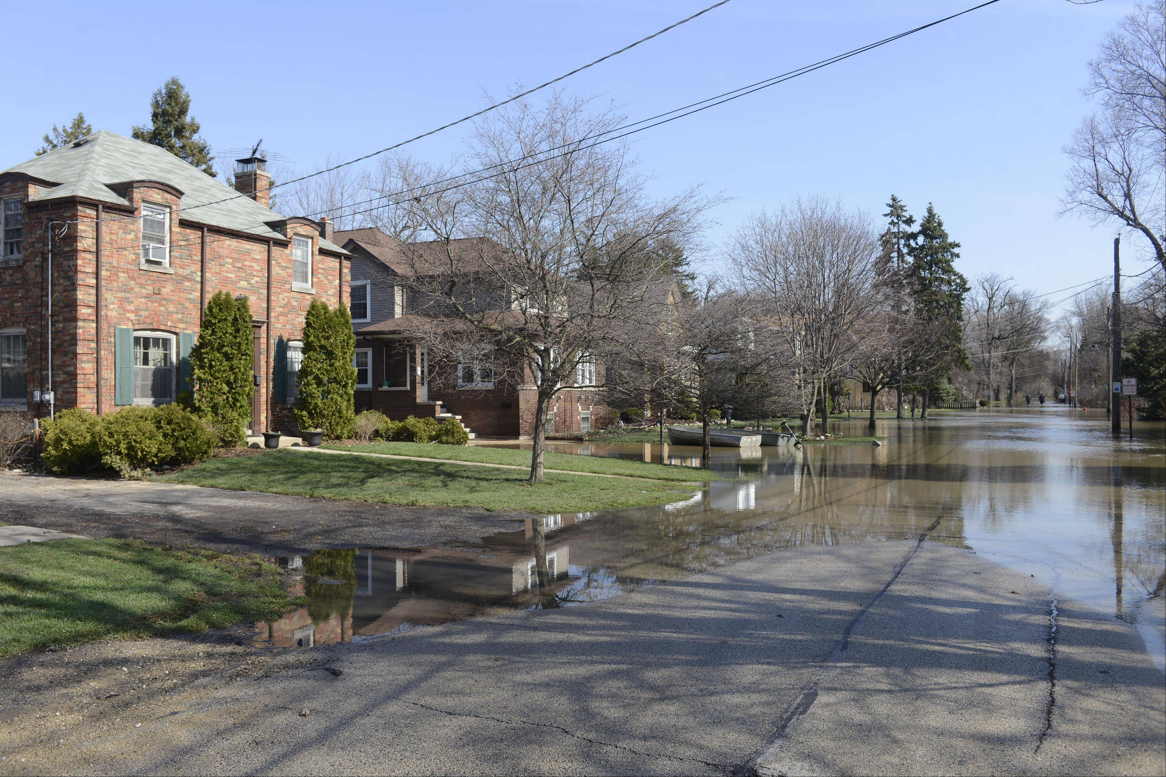 Floodwaters from the Des Plaines River on Hawthorne Lane in Des Plaines continue to recede Monday.