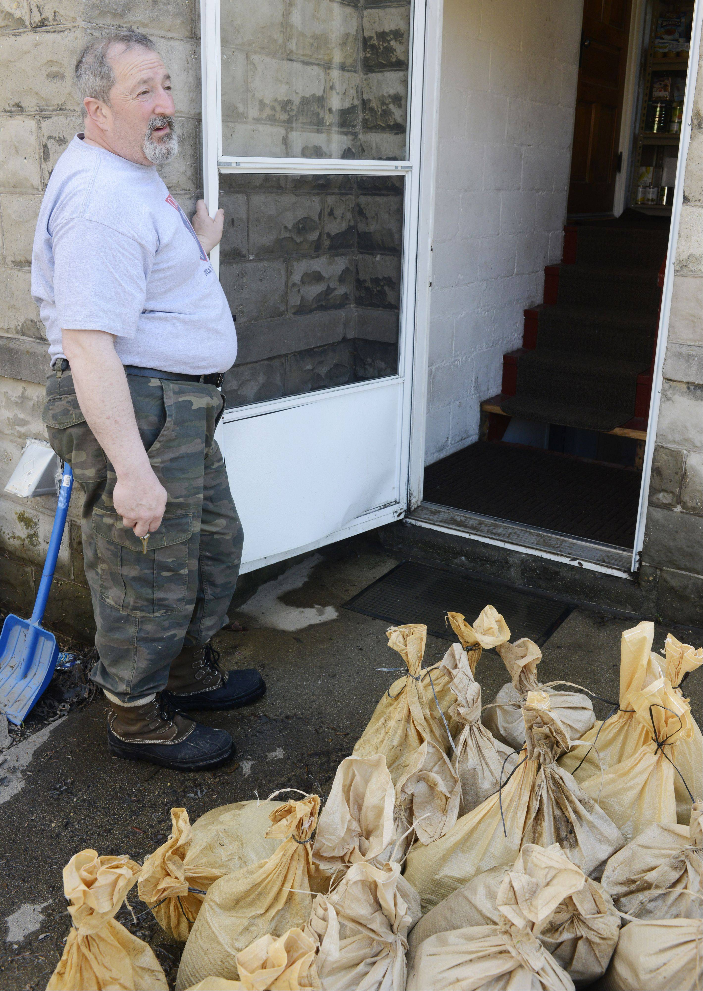 The sandbags have been moved out of the way, but Steven Brody said Monday that his back stairs will have to be replaced due to flood damage at his Walnut Avenue home in Des Plaines.