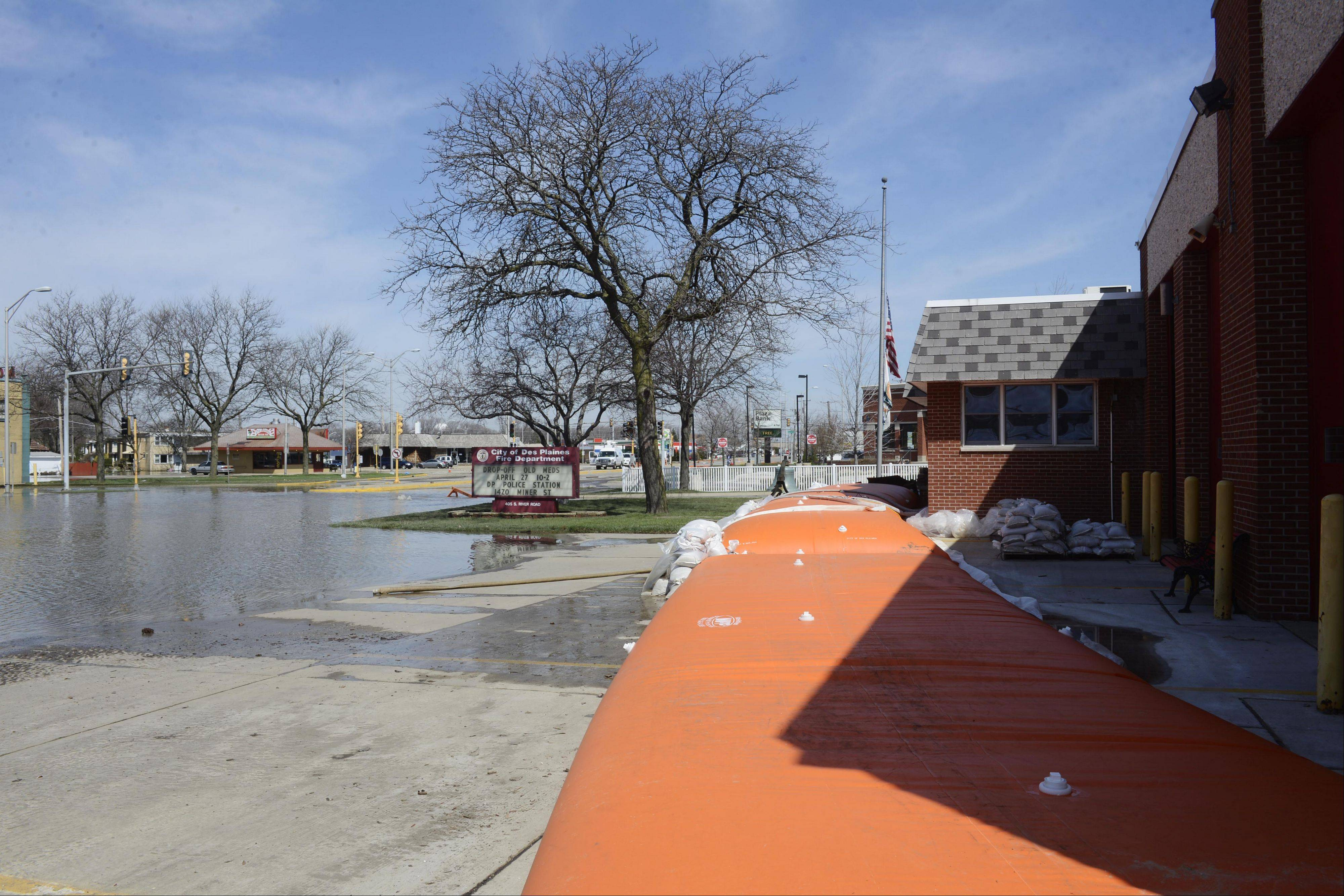 An inflatable device helps protect the front entrance to the Des Plaines fire department's station from floodwater near the intersection of Rand and River roads in Des Plaines Monday.