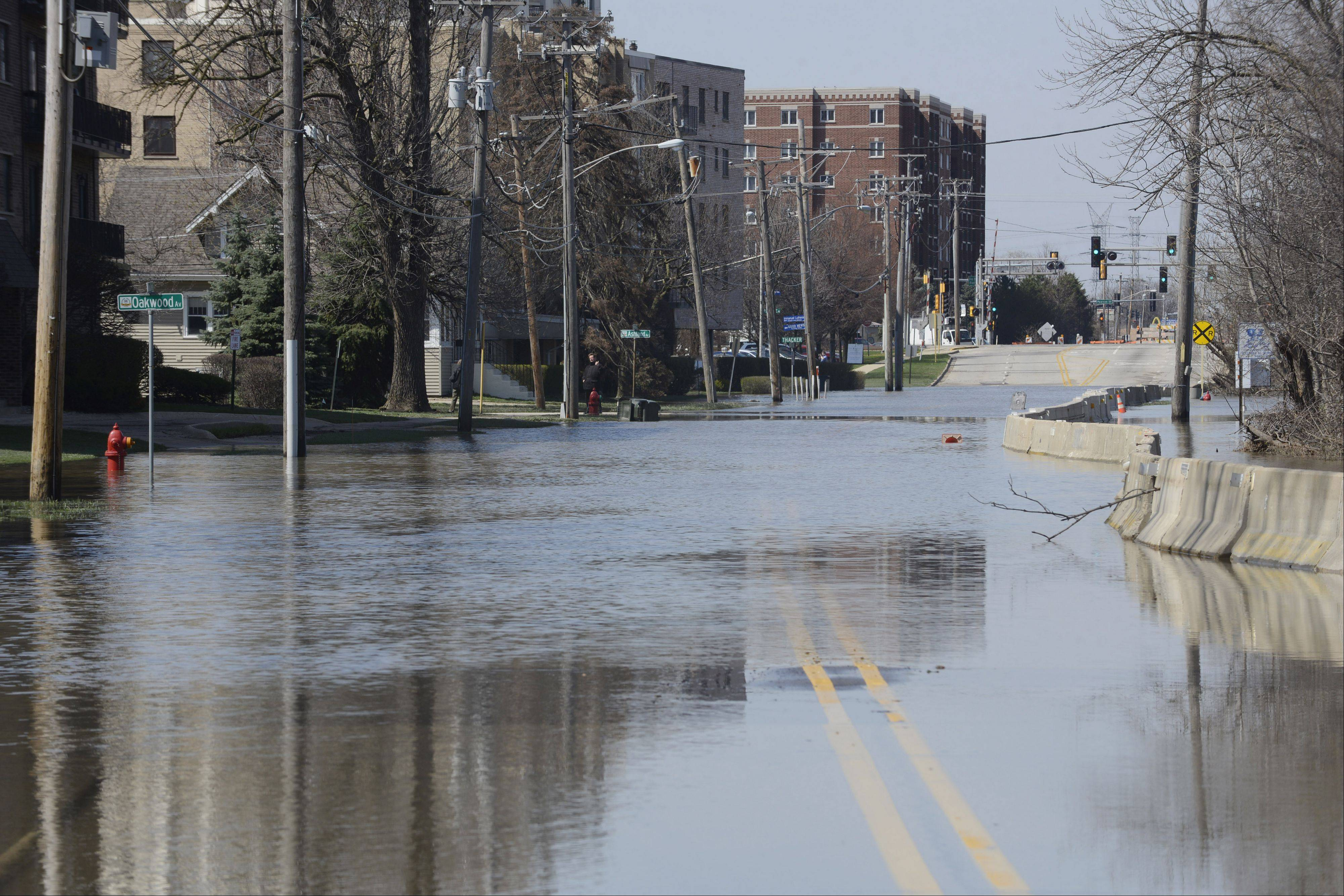 River Road south of downtown is still closed due to flooding in Des Plaines Monday.