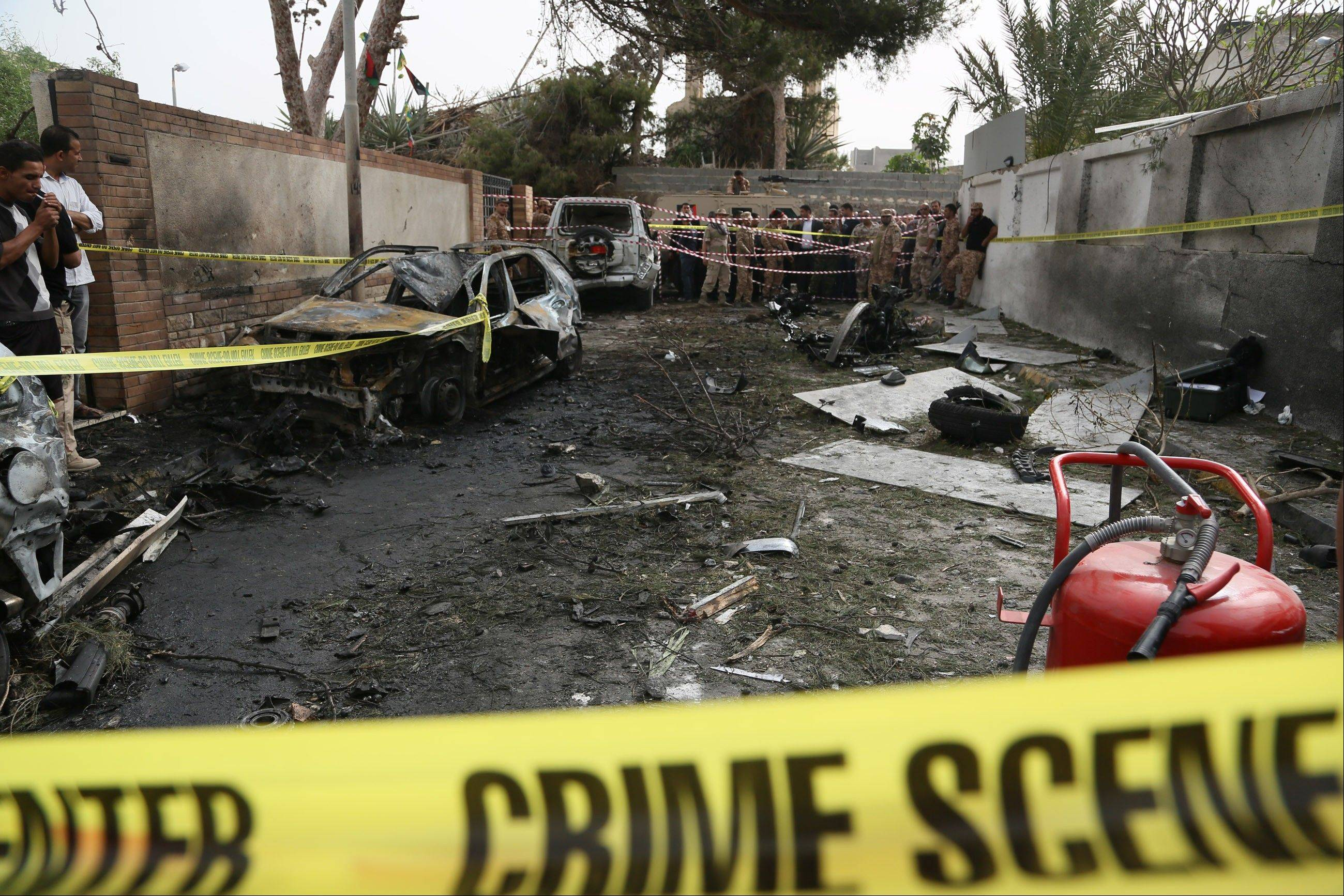 Police tape closes the site of a car bomb that targeted the French embassy wounding two French guards and causing extensive material damage in Tripoli, Libya, Tuesday, April 23, 2013. The explosives-laden car was detonated just outside the embassy building in Tripoli's upscale al-Andalus neighborhood, officials said.