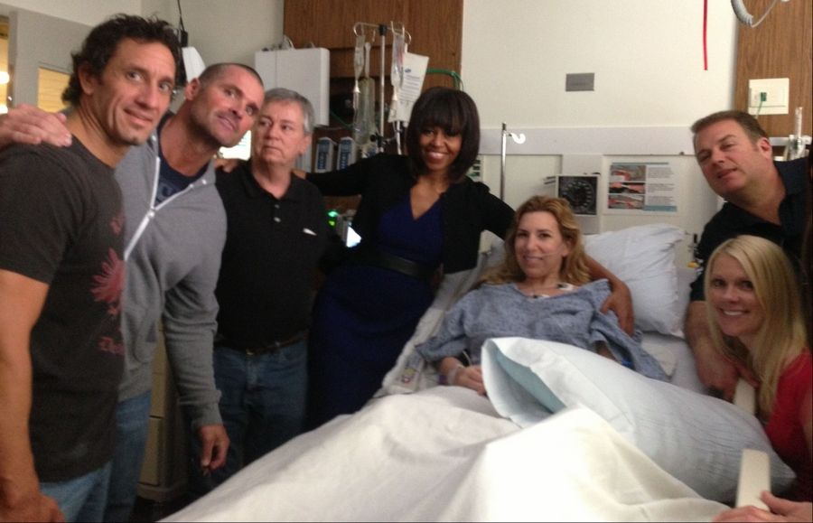 First lady Michelle Obama visits with Boston Marathon bombing victim Heather Abbott at Brigham and Women's Hospital in Boston. On the day of the bombings, Heather Abbott was scrambling to get off the sidewalk when the force of the second blast blew her through the restaurant doorway.
