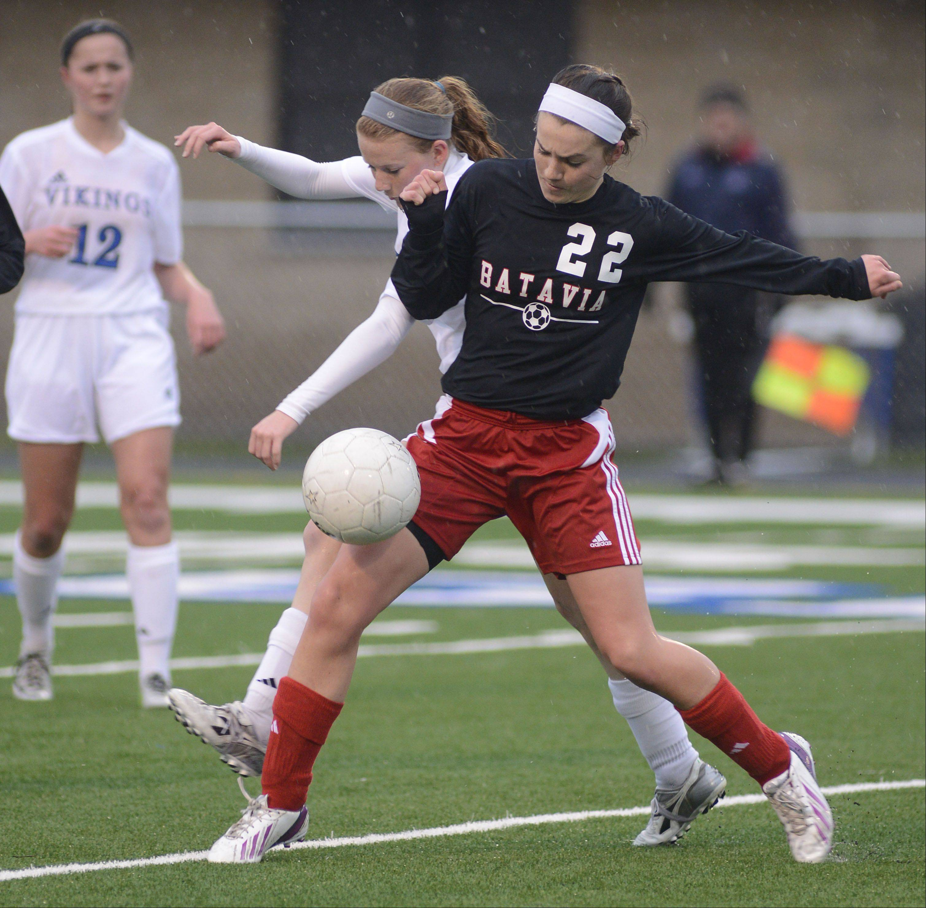 Batavia's Grace Andrews and Geneva's Hope Goodman battle for the ball in the first half on Tuesday, April 23.