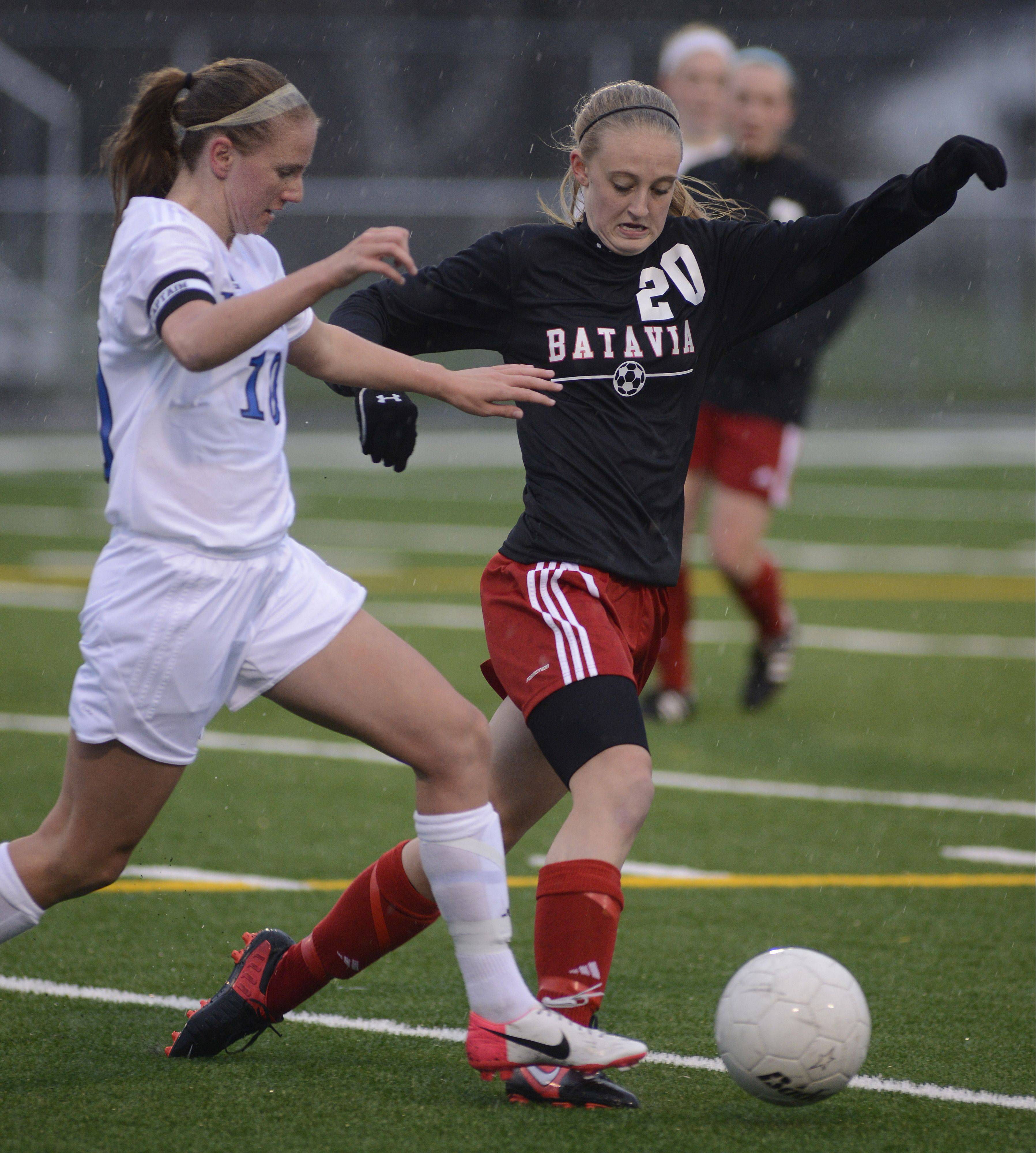 Geneva's Amanda Lulek and Batavia's Shelby Stone fight for the ball in the first half on Tuesday.