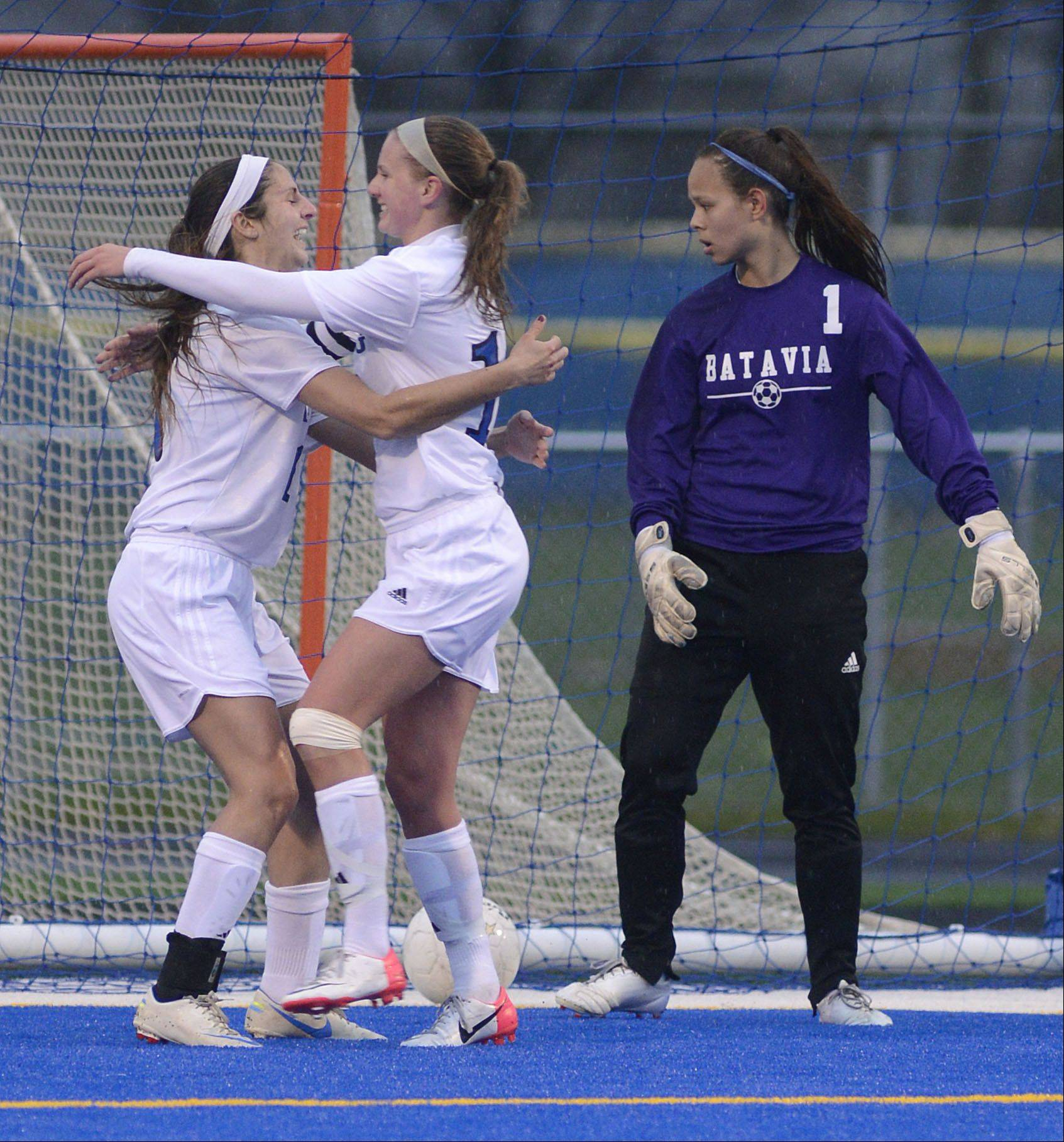 Genevaa; s Molly Axen, left, celebrates her goal with teammate Amanda Lulek as Batavia goalie Nicki Seiton looks back at the missed ball in the first half on Tuesday, April 23.