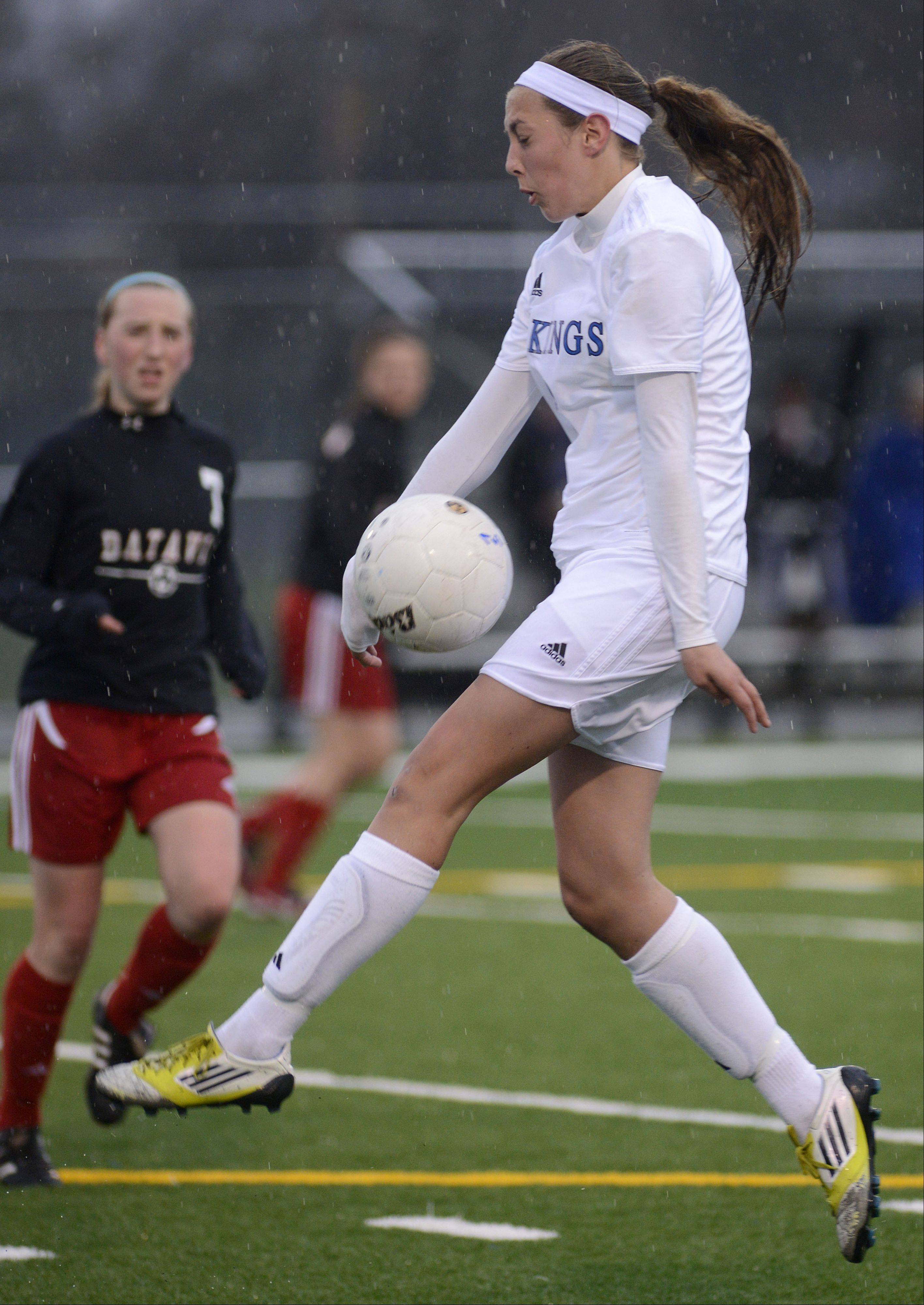 Geneva's Megan Fitz receives the ball and directs it downward during the first half on Tuesday, April 23.