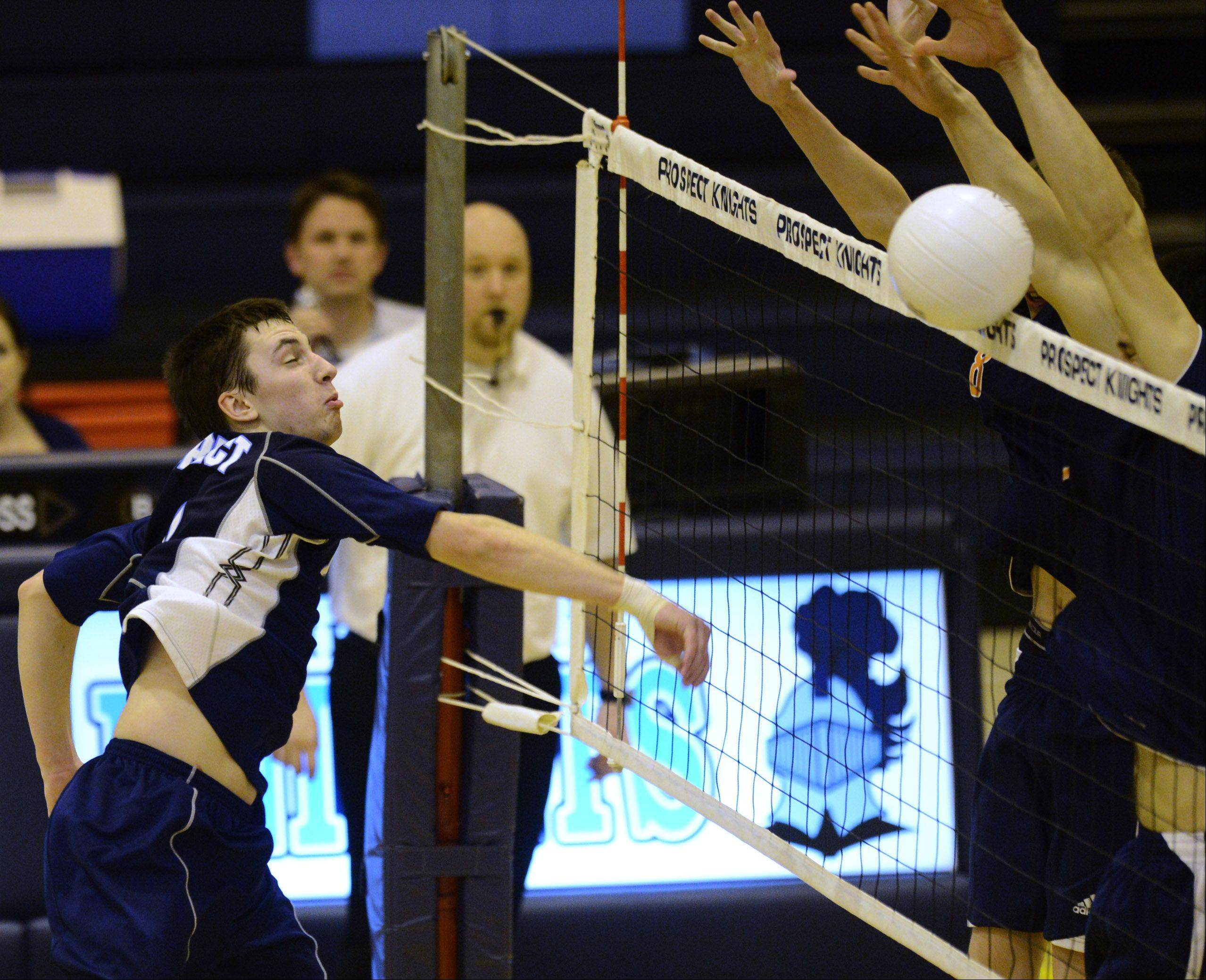 Prospect's Curtis Glennon hits a ball that gets blocked at the net by Buffalo Grove Tuesday.