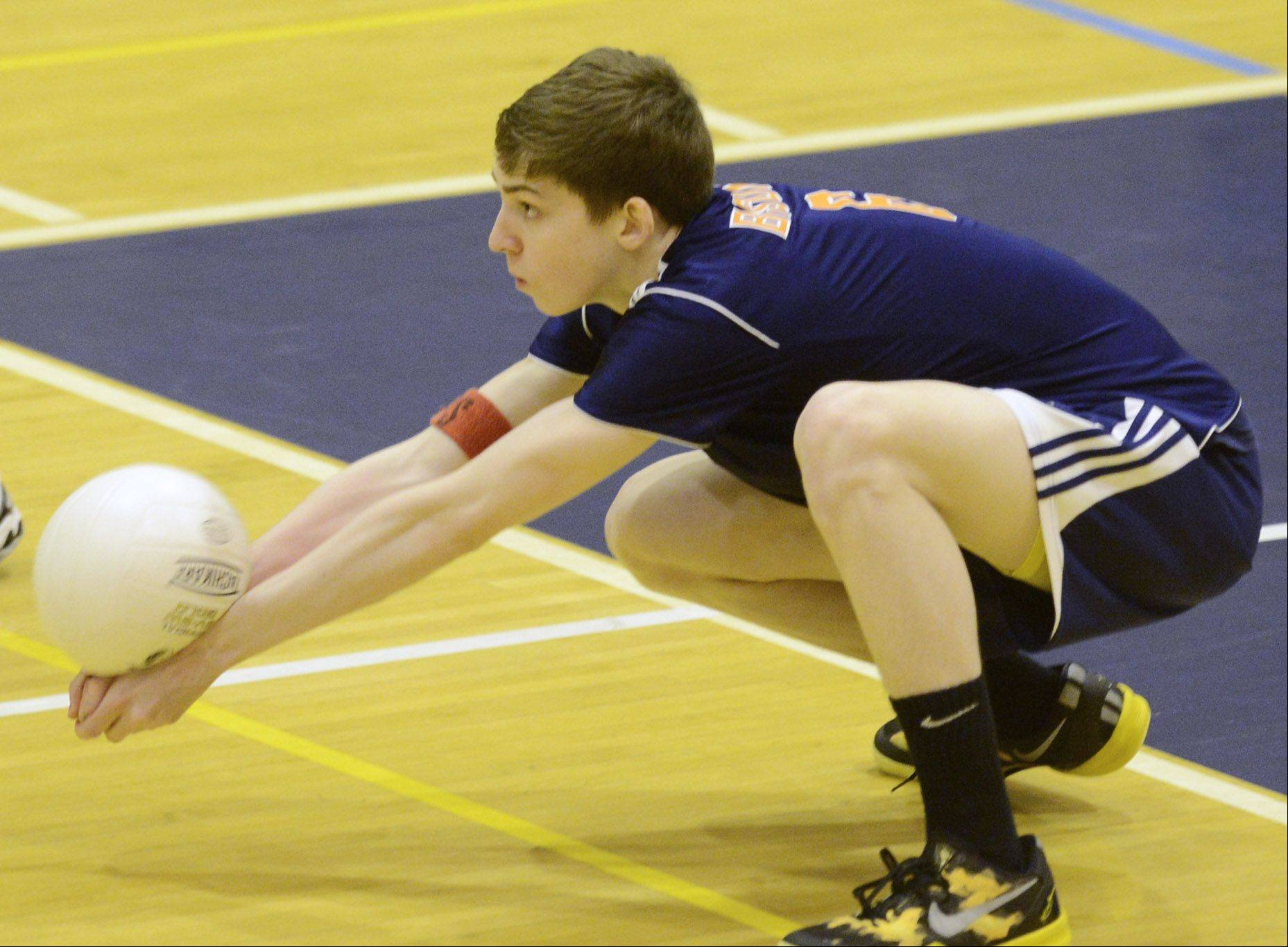 Buffalo Grove's Evan Bunnetto goes low for a dig against Prospect Tuesday.