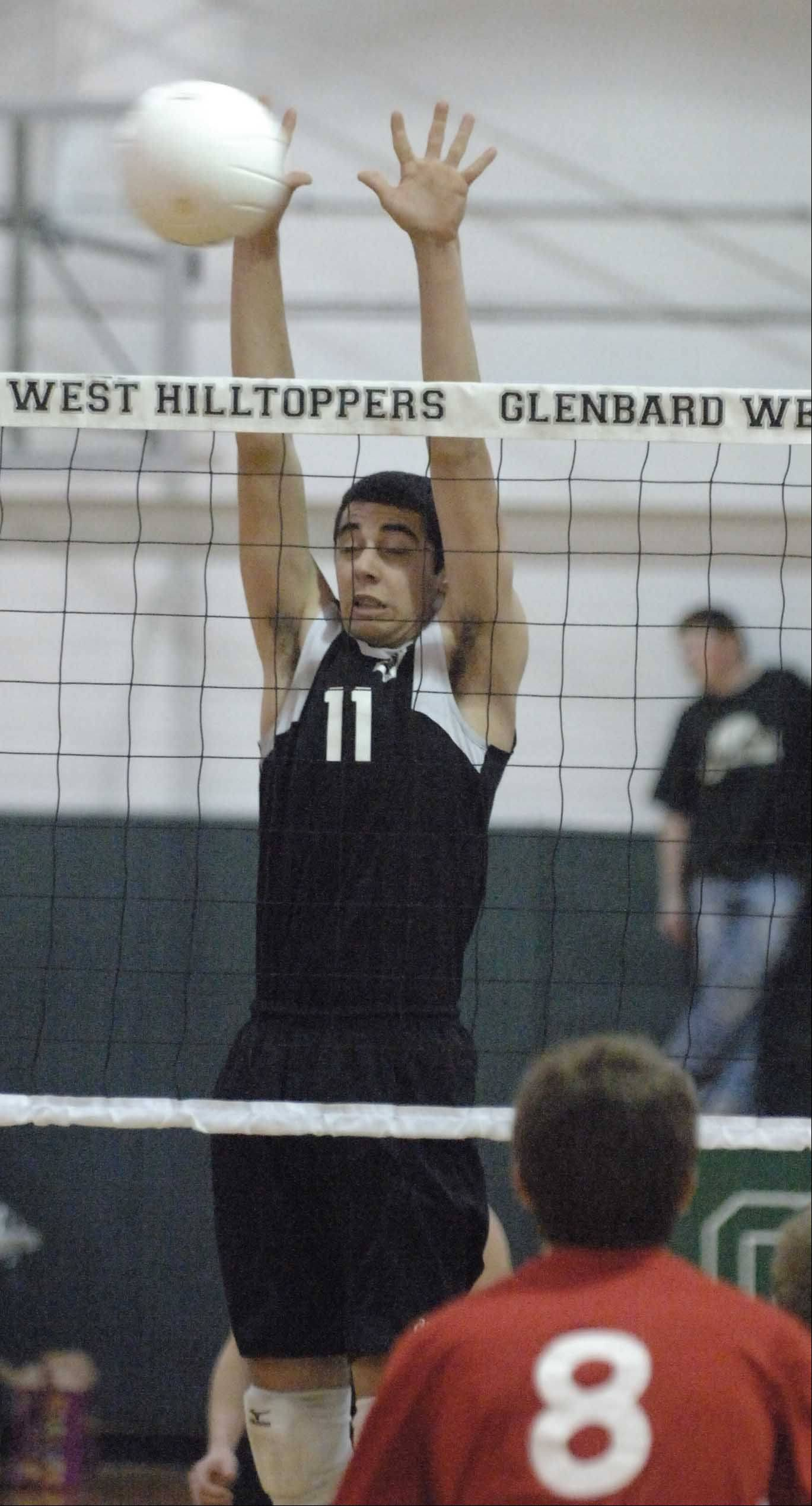 Kyle Blane of Glenbard West goes up for a block during the Hinsdale Central at Glenbard West boys volleyball game Tuesday.