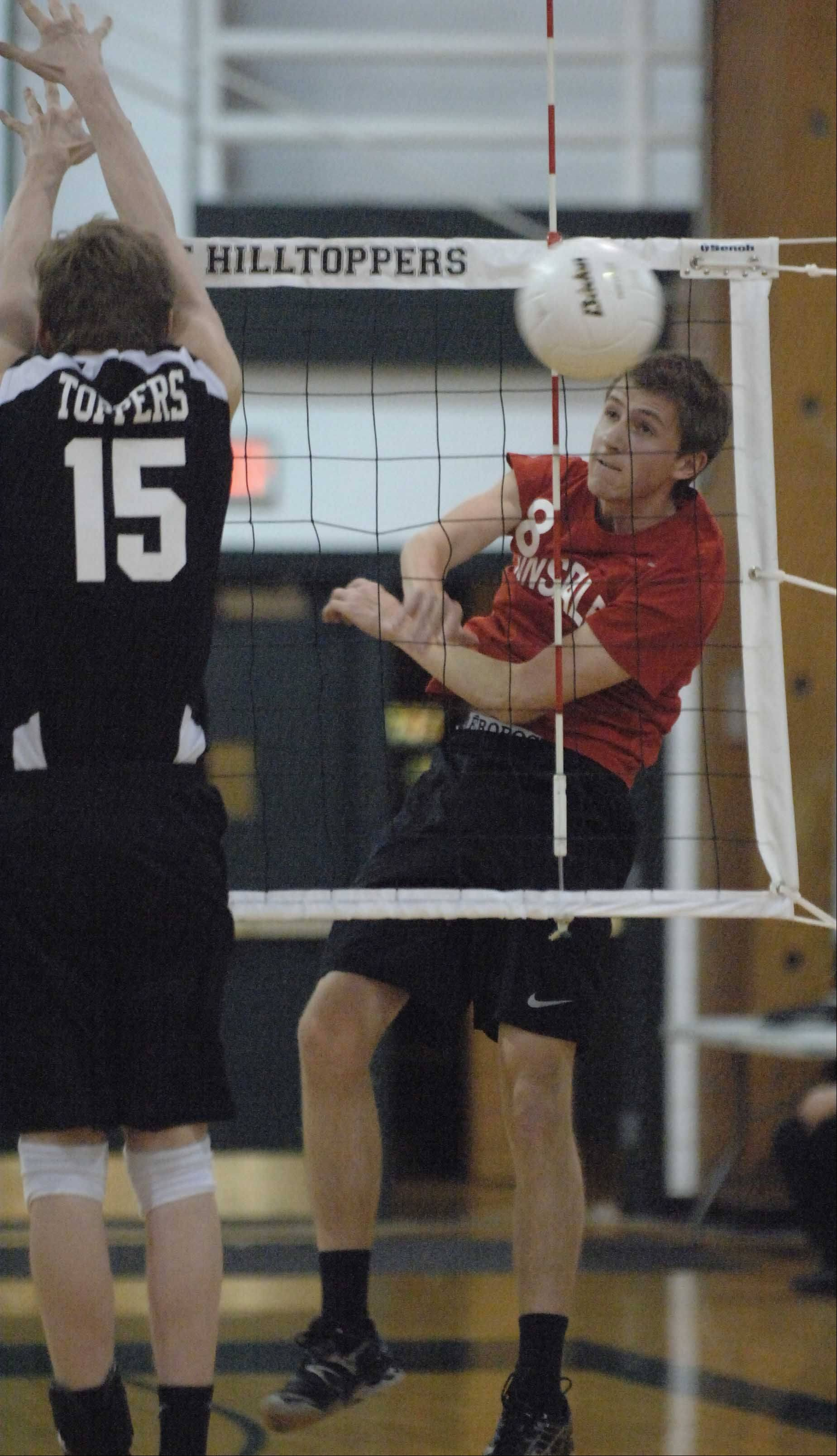 Jackson Nagle of Glenbard West,left, and Danny Flynn of Hinsdale Central during the Hinsdale Central at Glenbard West boys volleyball game Tuesday.