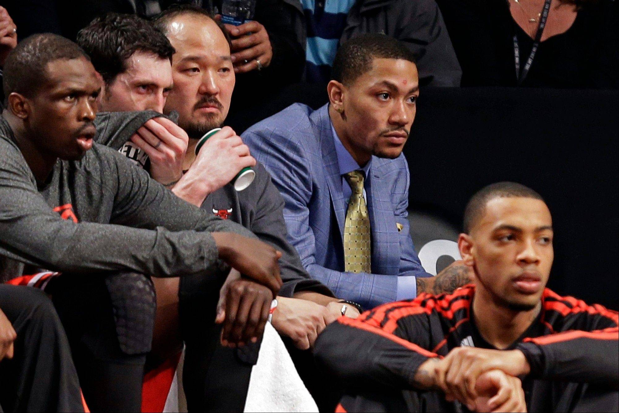 Bulls guard Derrick Rose, second from right, watches from the bench during the second half of Game 2 of a first-round playoff series against the Brooklyn Nets.