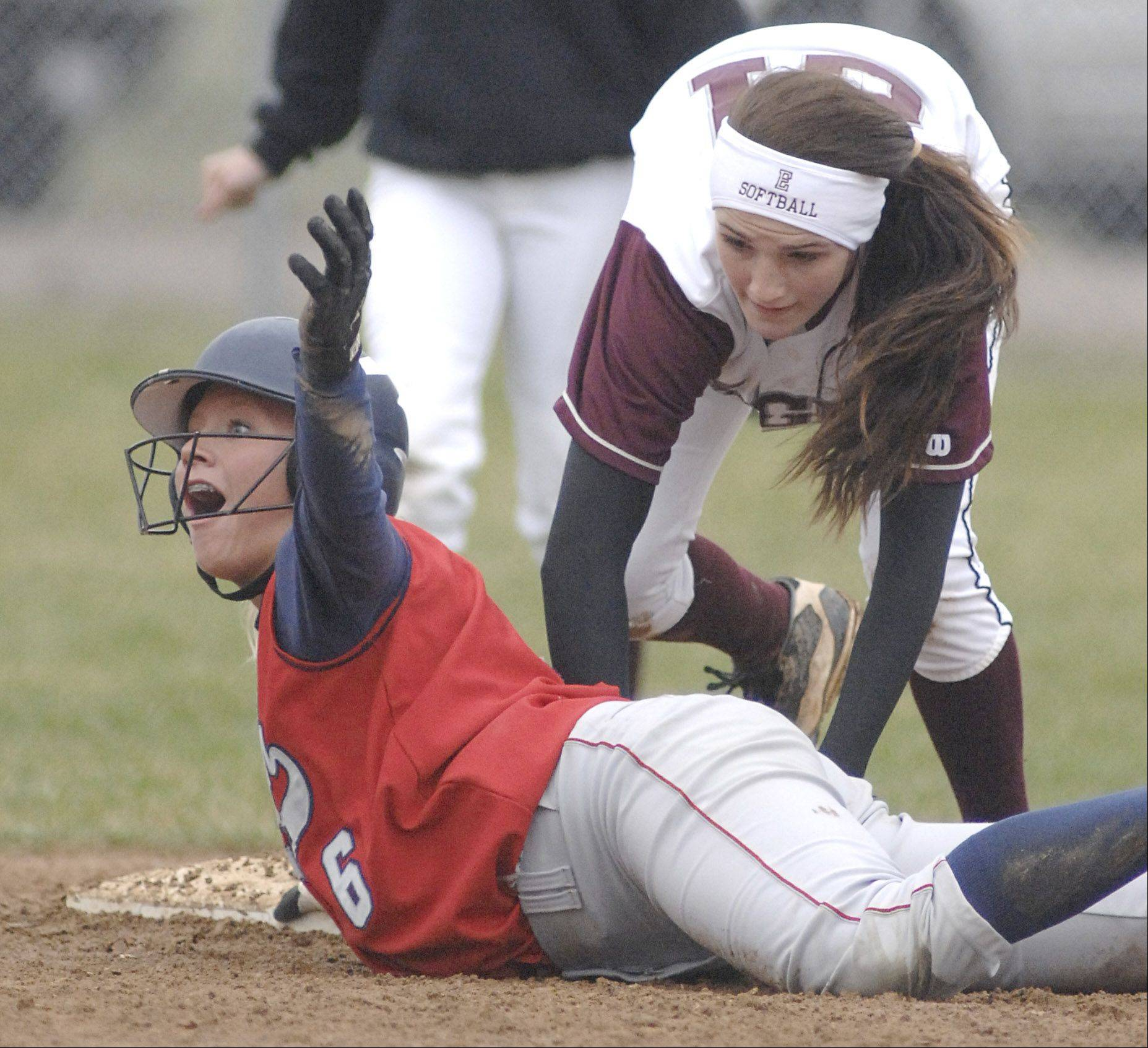 South Elgin senior Kara Rodriguez objects to being called out at second base in a game against Elgin last season. Rodriguez has been selected to the University of North Texas cheerleading team.