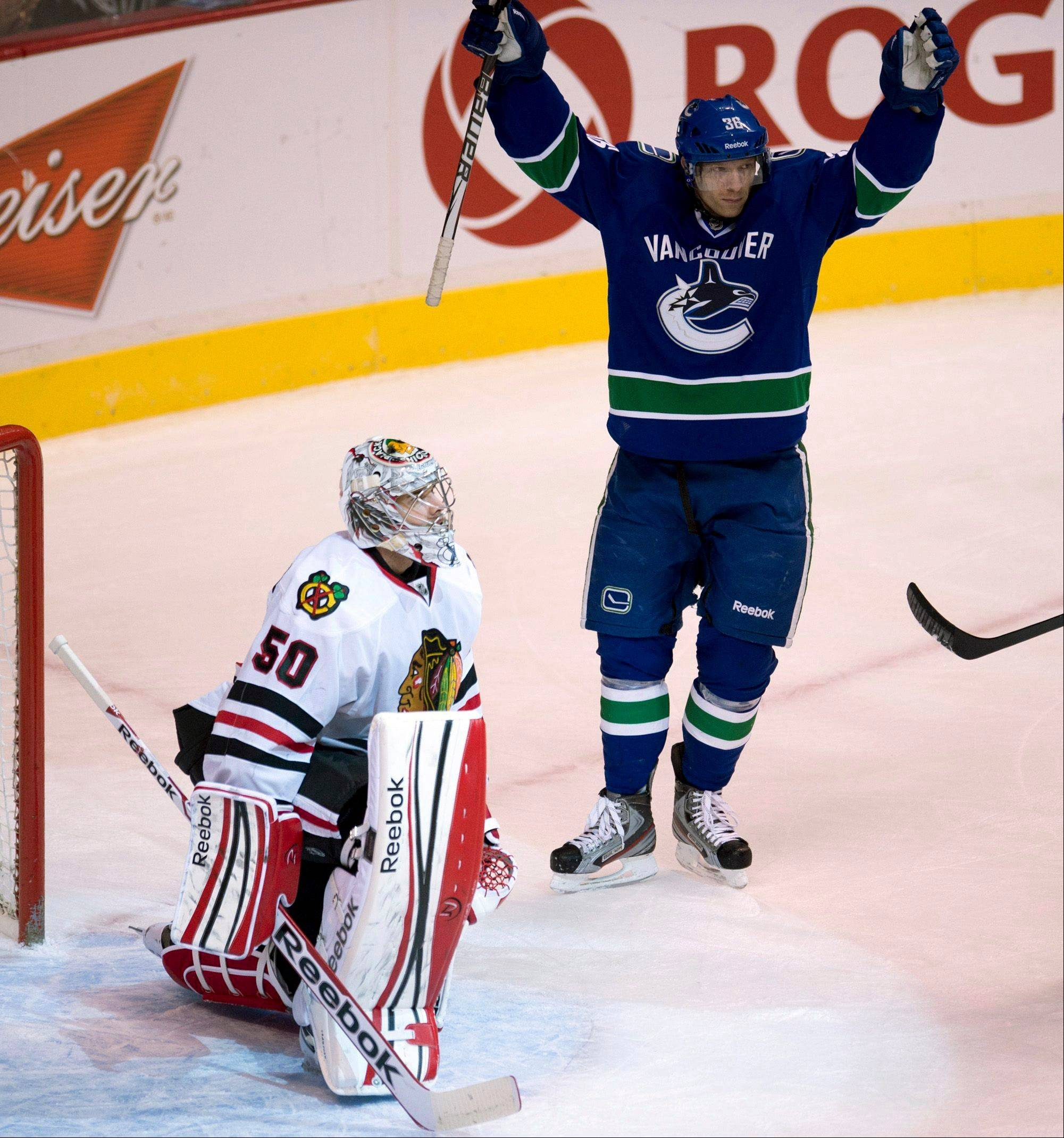 Vancouver Canucks right wing Jannik Hansen (36) celebrates his goal past Chicago Blackhawks goalie Corey Crawford (50) during the first period of their NHL hockey game in Vancouver, British Columbia, Monday, April 22, 2013.