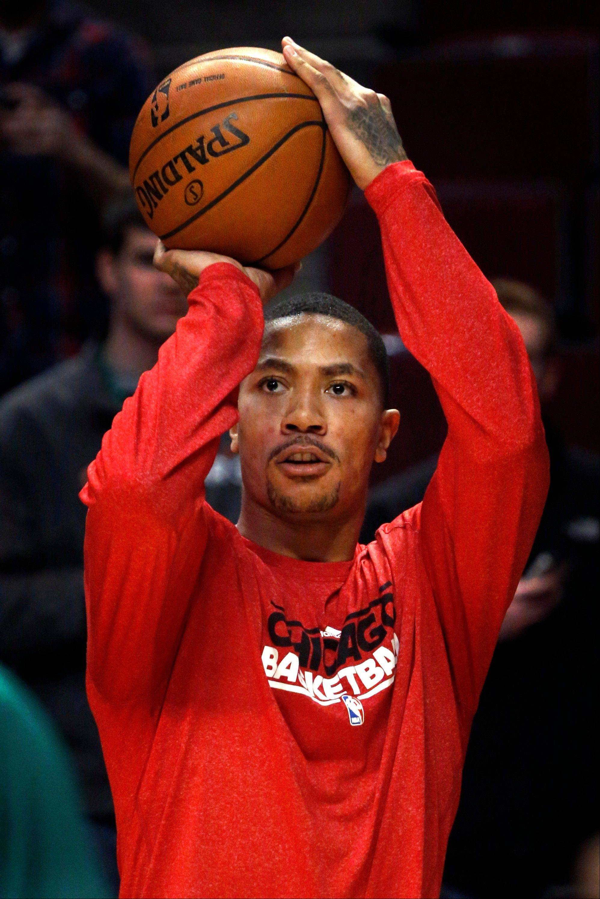 The Bulls' Derrick Rose has been able to work out before games, but he has not returned to action as he continues his rehabilitation from surgery to repair a torn anterior cruciate ligament in his left knee.