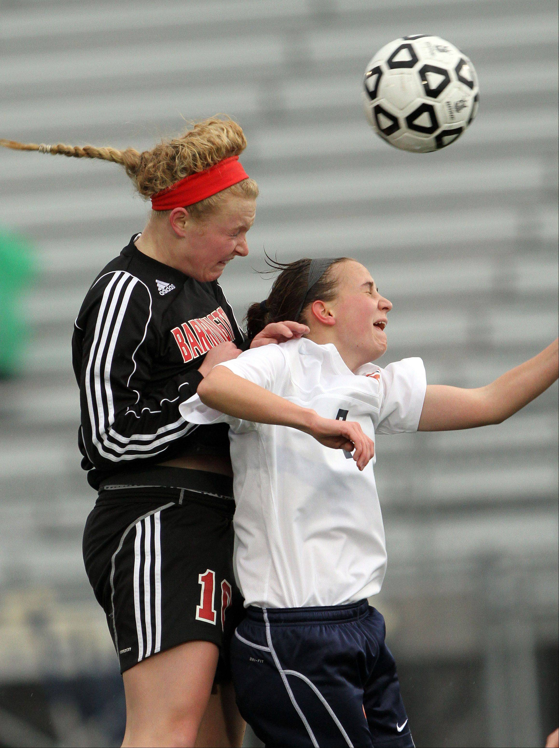 Barrington's Molly Pfeiffer, left, and Buffalo Grove's Jessica Kovach go up for a header during their game Monday night at Buffalo Grove High School.