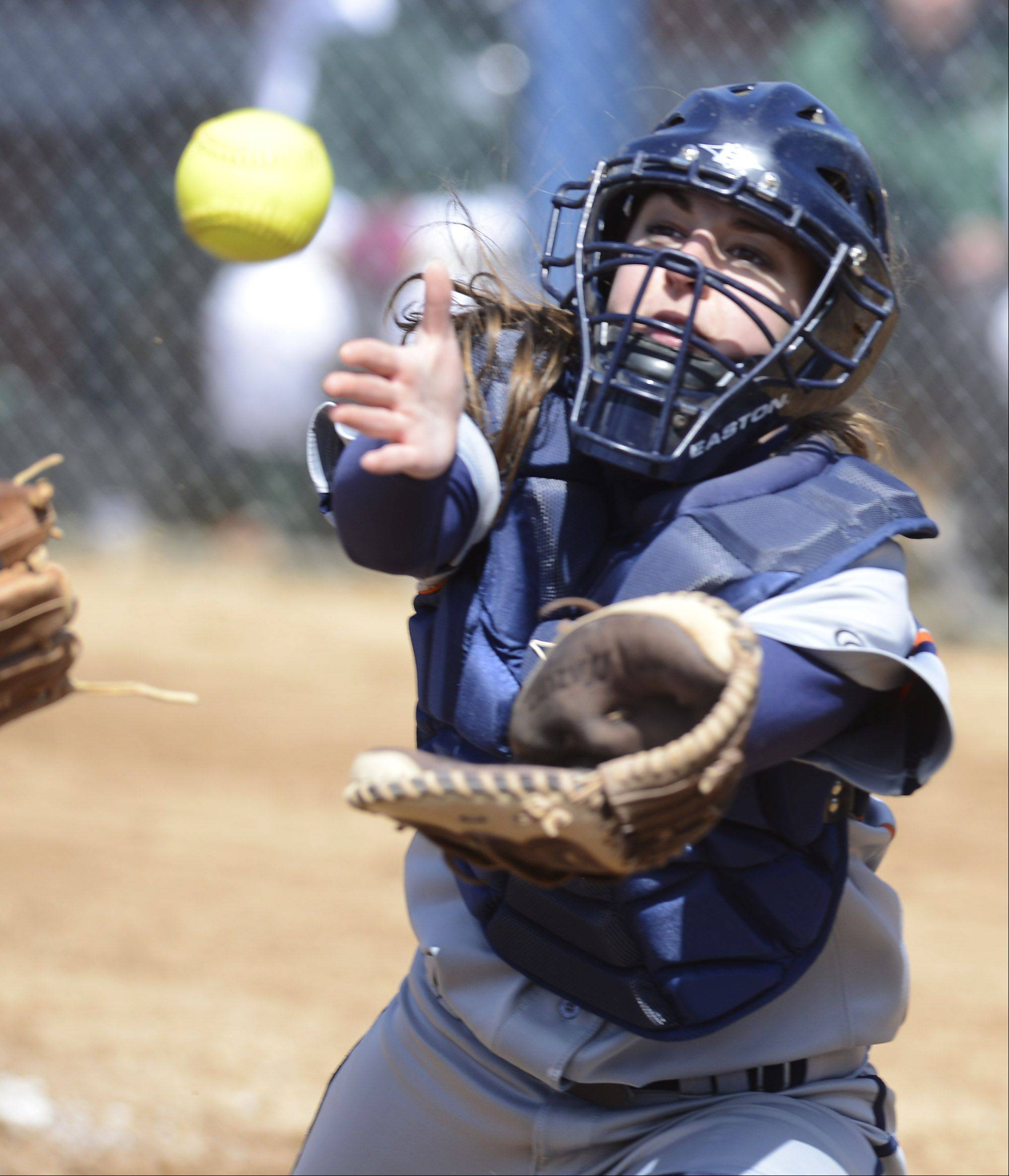 Buffalo Grove's Amanda Salzman closes in on the ball during Saturday's softball game against Elk Grove.