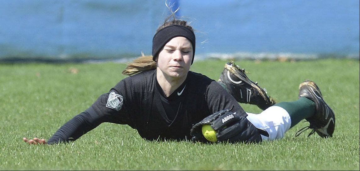 Elk Grove's Brianna Leach makes a diving catch during Saturday's softball game against Buffalo Grove.