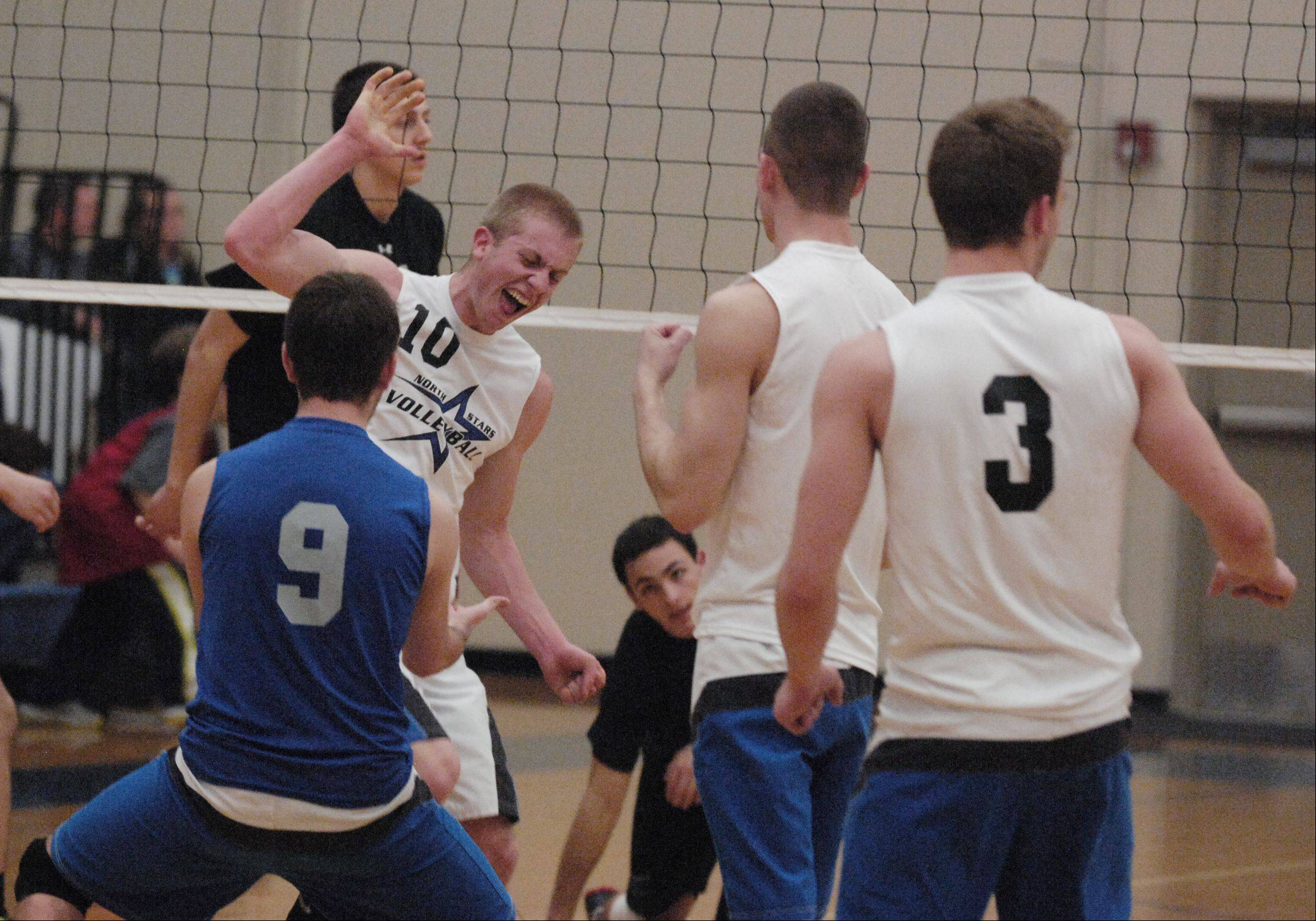 St. Charles North's Kevin Beach celebrates during Monday's volleyball match against St. Francis in Wheaton.