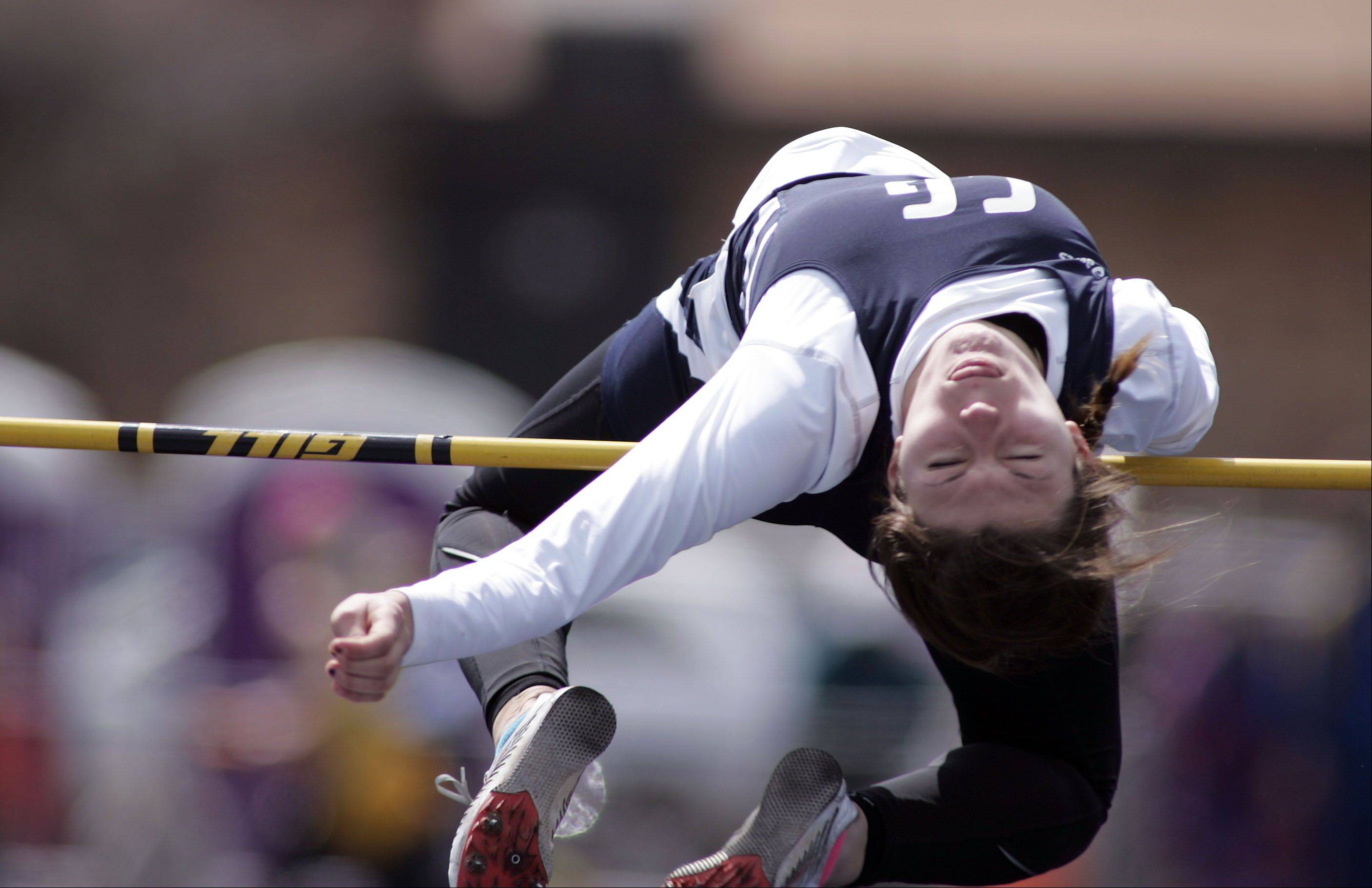Cary-Groves Erik Sternard competes in the high jump during the McHenry County boys and girls track meet Saturday at Cary-Grove High School in Cary.