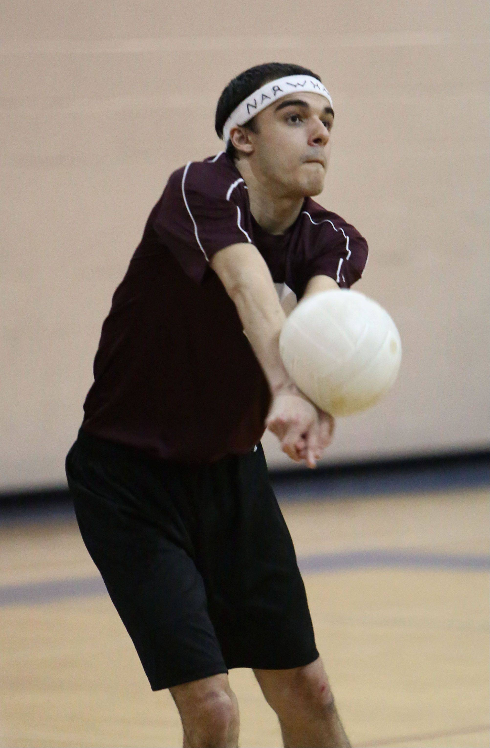 Antioch's Ian Keller returns a serve during their game Wednesday night at Lakes High School.