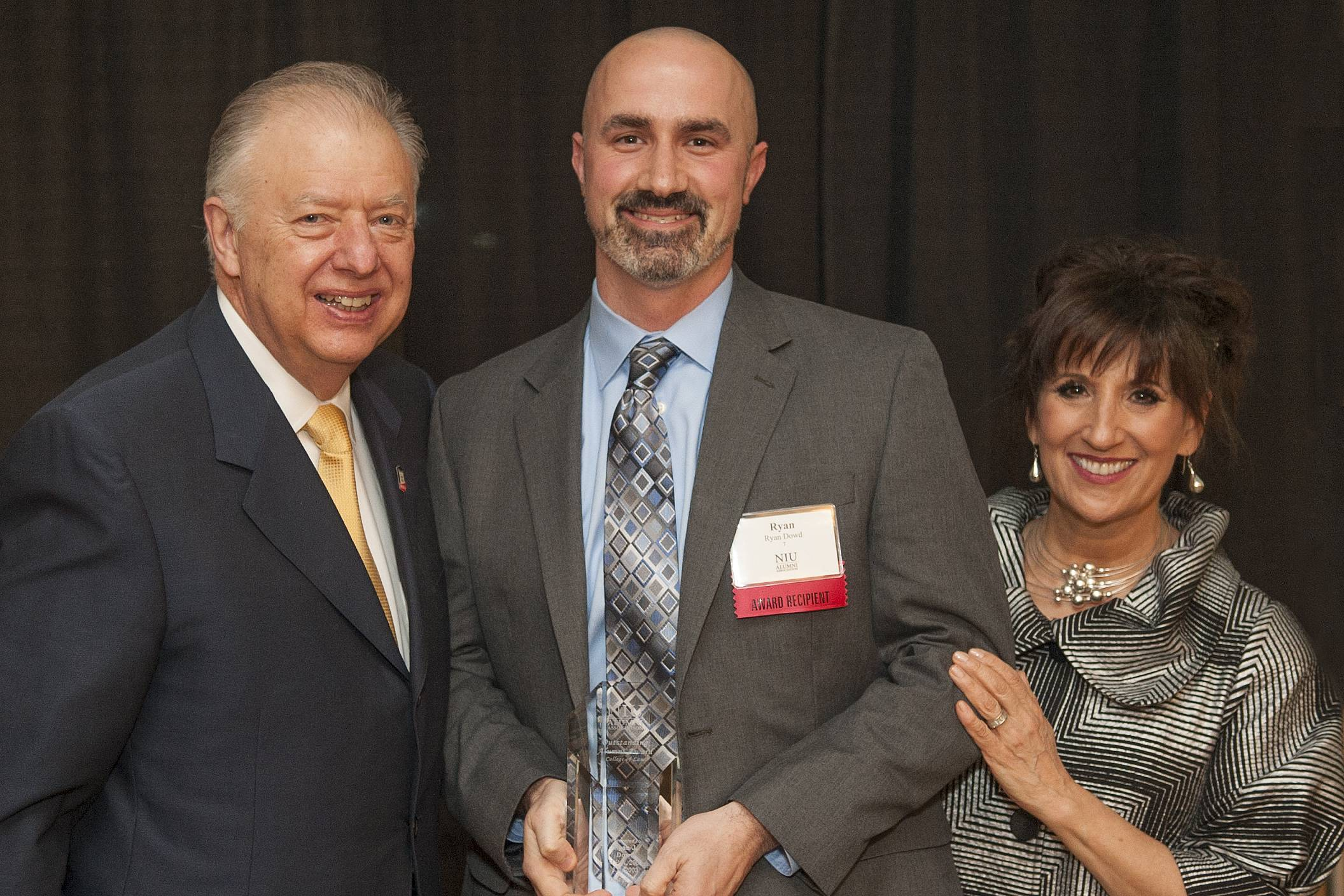 NIU Law Outstanding Alumni Award recipient Ryan Dowd ('03) is pictured (center) with NIU President John G. Peters and Francine Pepitone, President of the NIU Alumni Association Board of Directors during the 2013 NIU Alumni Association Awards Program.