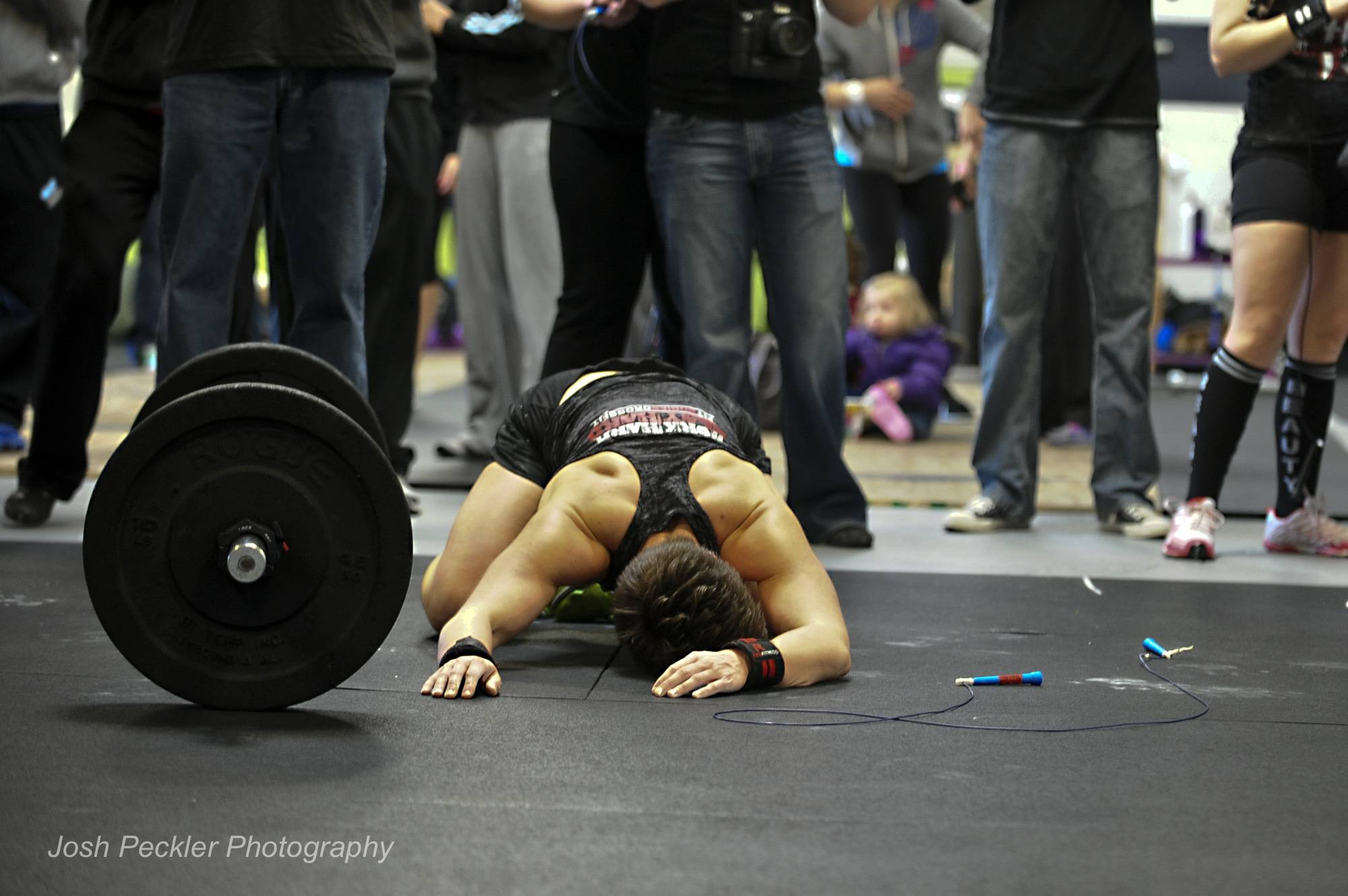 Jennifer Silva McDade, Bloomington, collapses after completing one of the three qualifying workouts at the April 20 Athena Classic Hosted by Elite Athletic Development / CrossFit Arlington Heights.