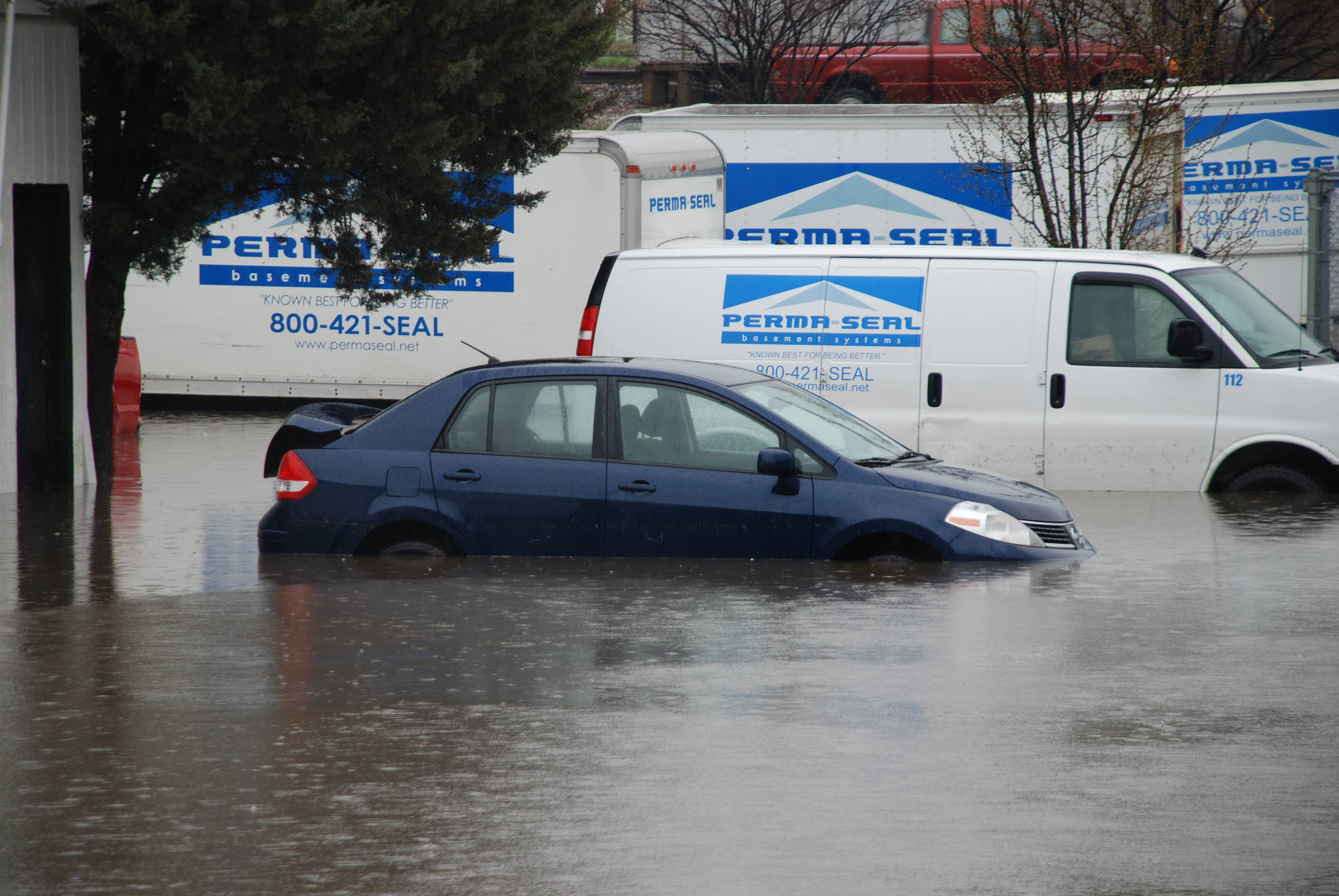 The Perma-Seal office in Downers Grove, along with many of their service vehicles, was underwater on Thursday, April 18, 2013.