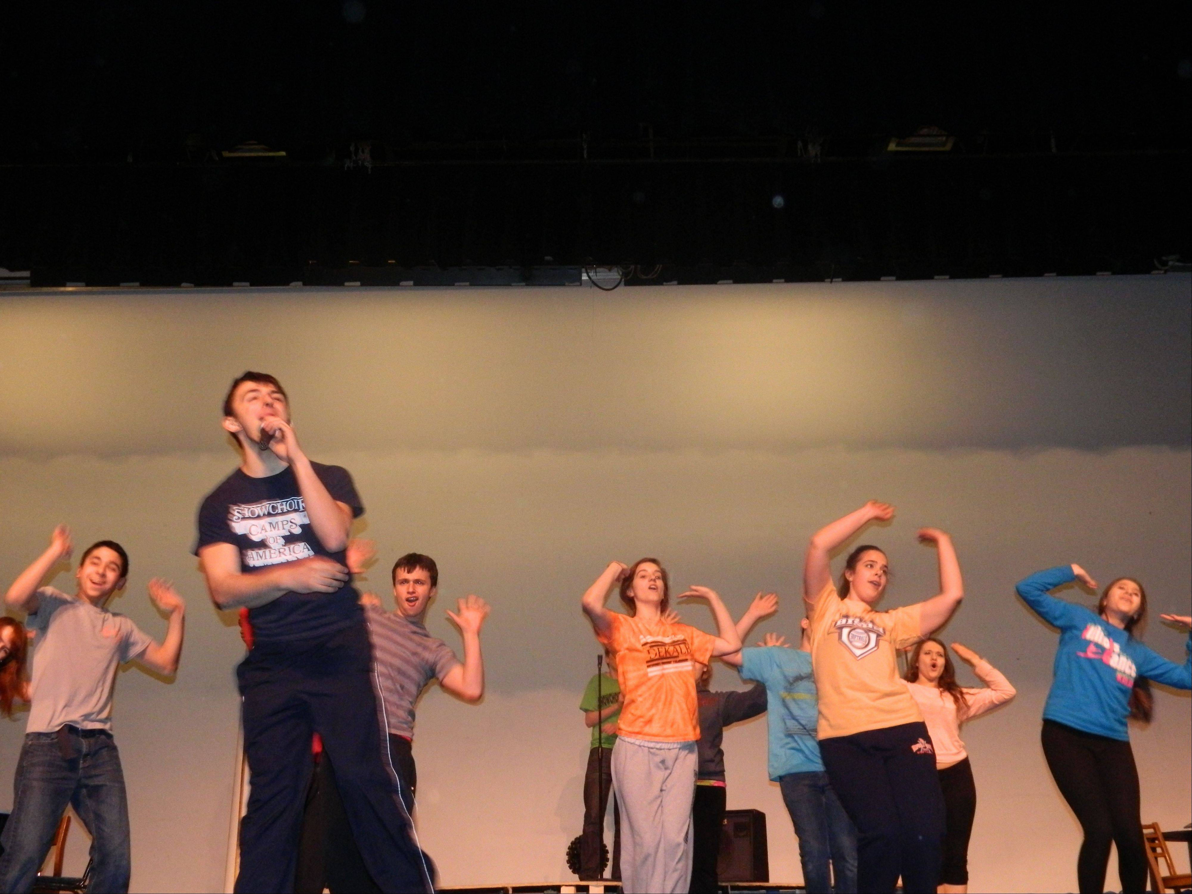 "Buffalo Grove High School students rehearse for the spring musical ""The Wedding Singer."""