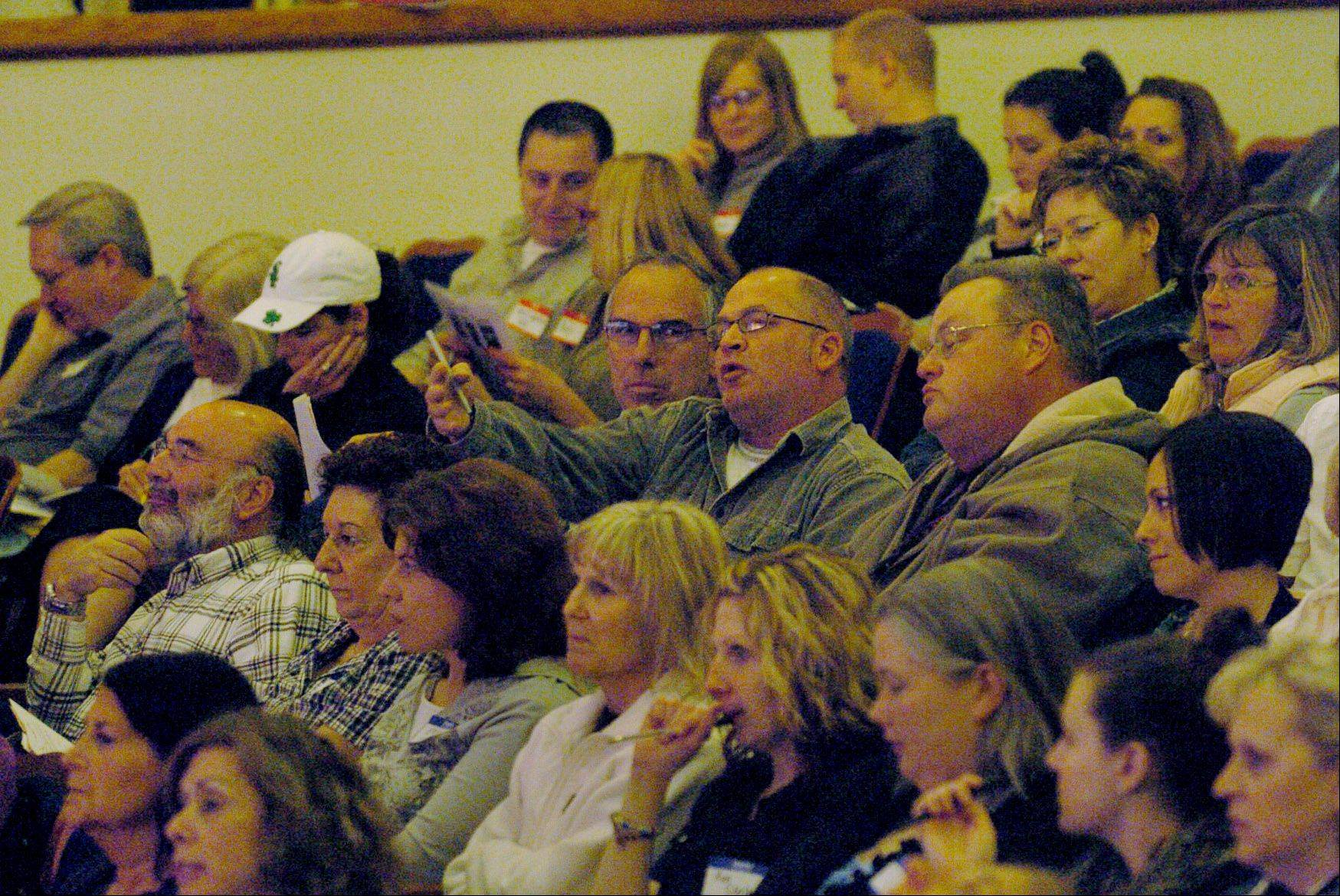 An angry crowd reacted to talk on pensions during an Illinois Education Association forum in 2011 at Palatine's Cutting Hall. Tonight's forum will offer a variety of viewpoints on the pension crisis.