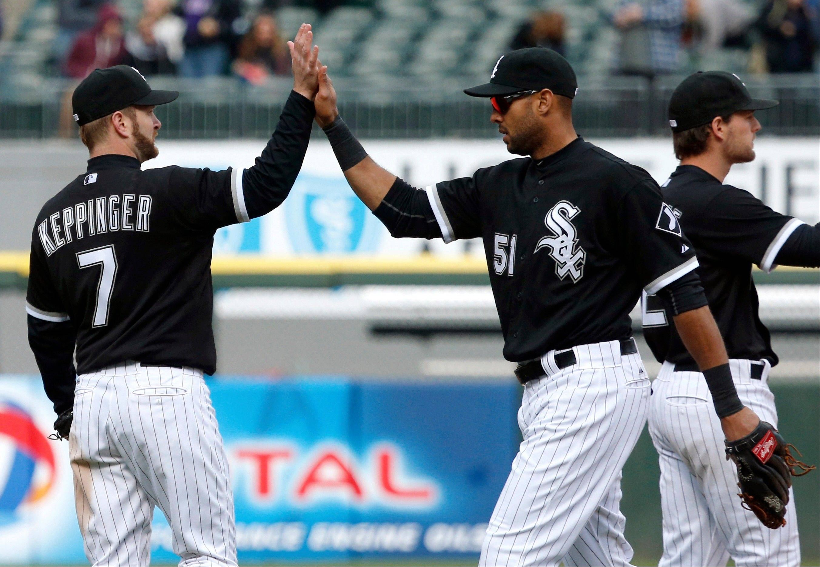 Chicago White Sox third baseman Jeff Keppinger (7) celebrates with right fielder Alex Rios (51) after their 3-2 win over the Cleveland Indians in a baseball game, Wednesday, April 24, 2013, in Chicago. (AP Photo/Charles Rex Arbogast)