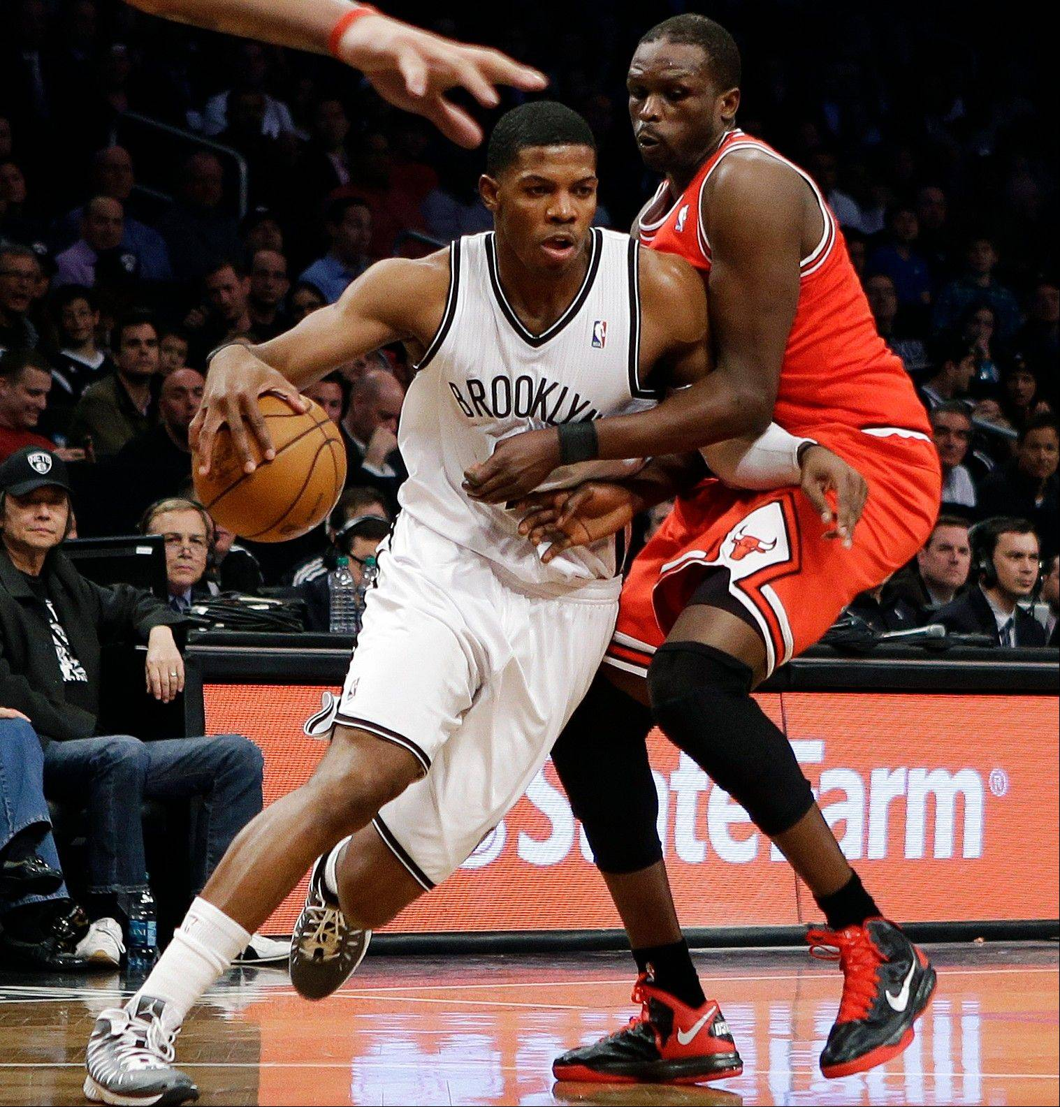 Brooklyn Nets guard Joe Johnson, left, is questionable for Game 3 against Chicago due to a foot injury, plantar fasciitus.
