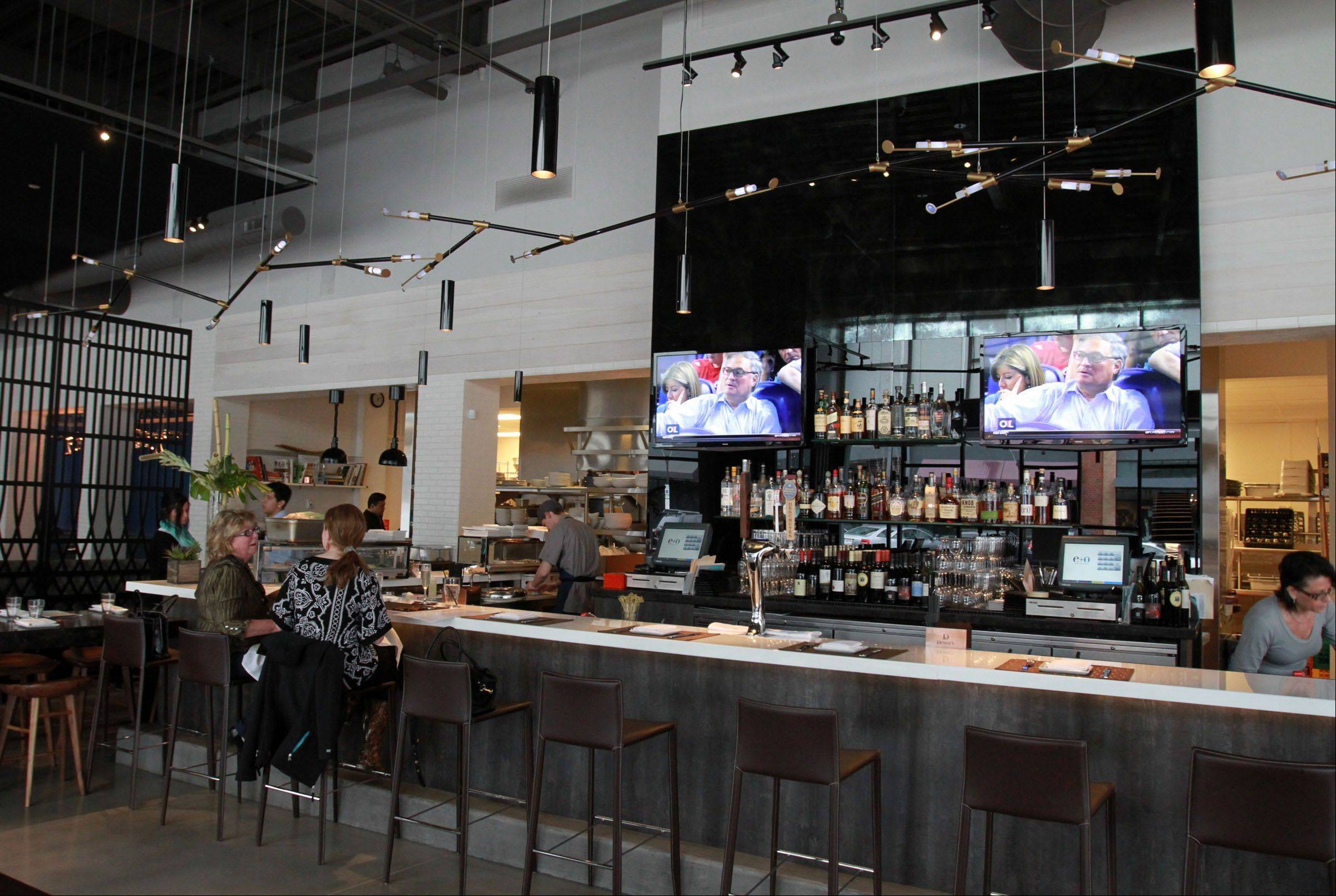 You can grab a cocktail before dinner or a movie in the bar area at e+o Food and Drink in Mount Prospect.