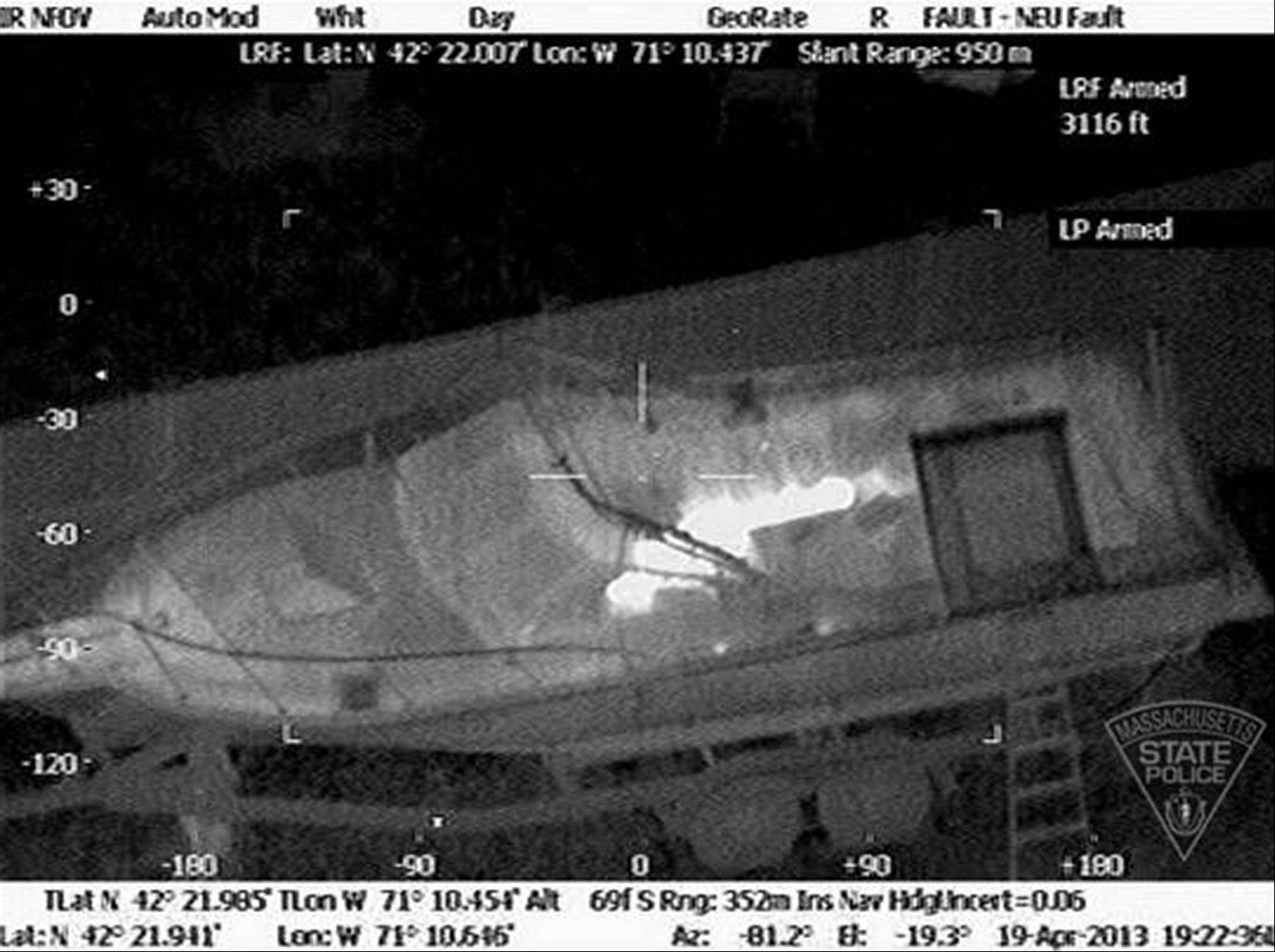 Boston Marathon bombing suspect, Dzhokhar Tsarnaev, hiding inside a boat during a search for him in Watertown, Mass.