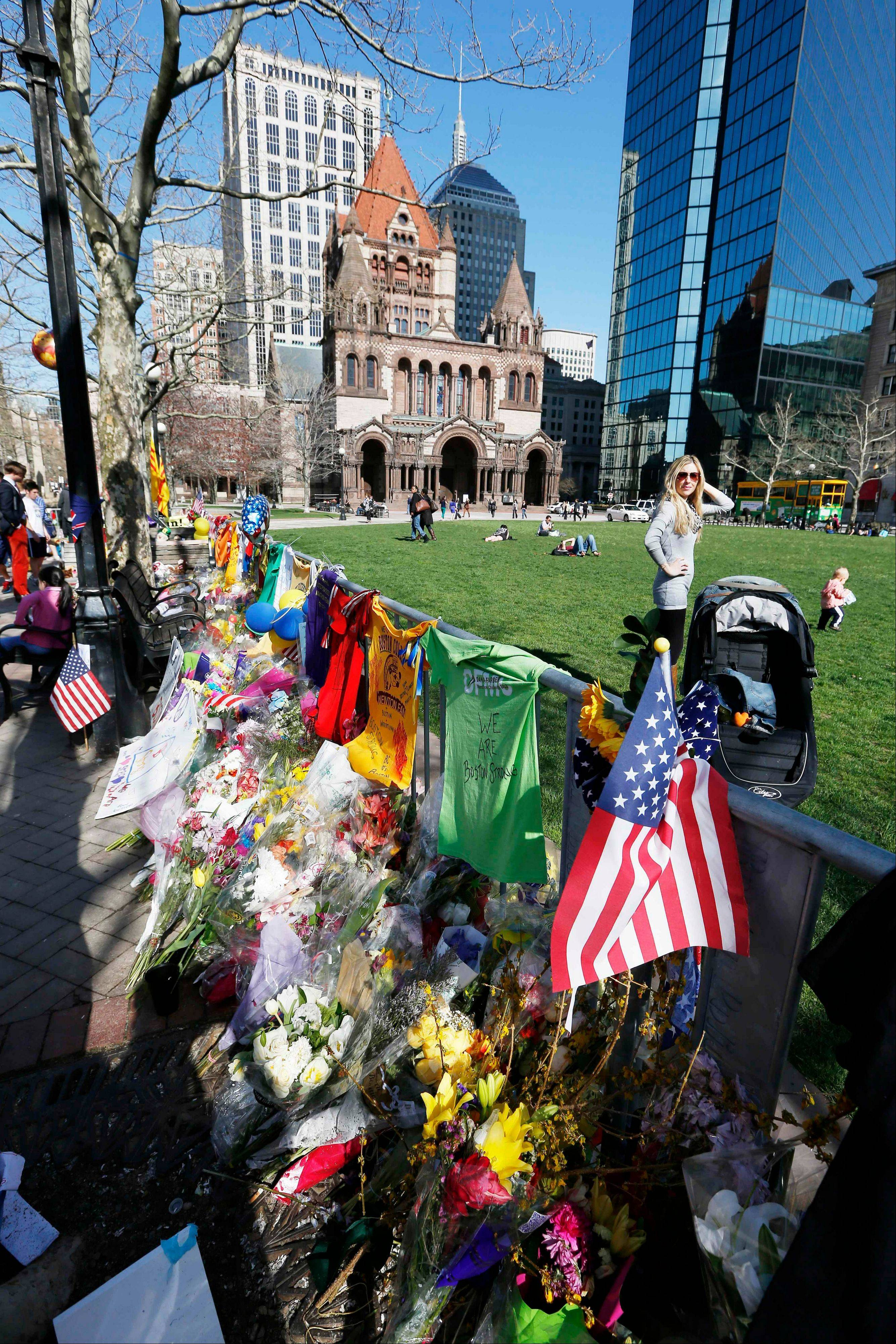 Various items were on display Wednesday at a makeshift memorial to the bombing victims on Boylston Street in Boston.