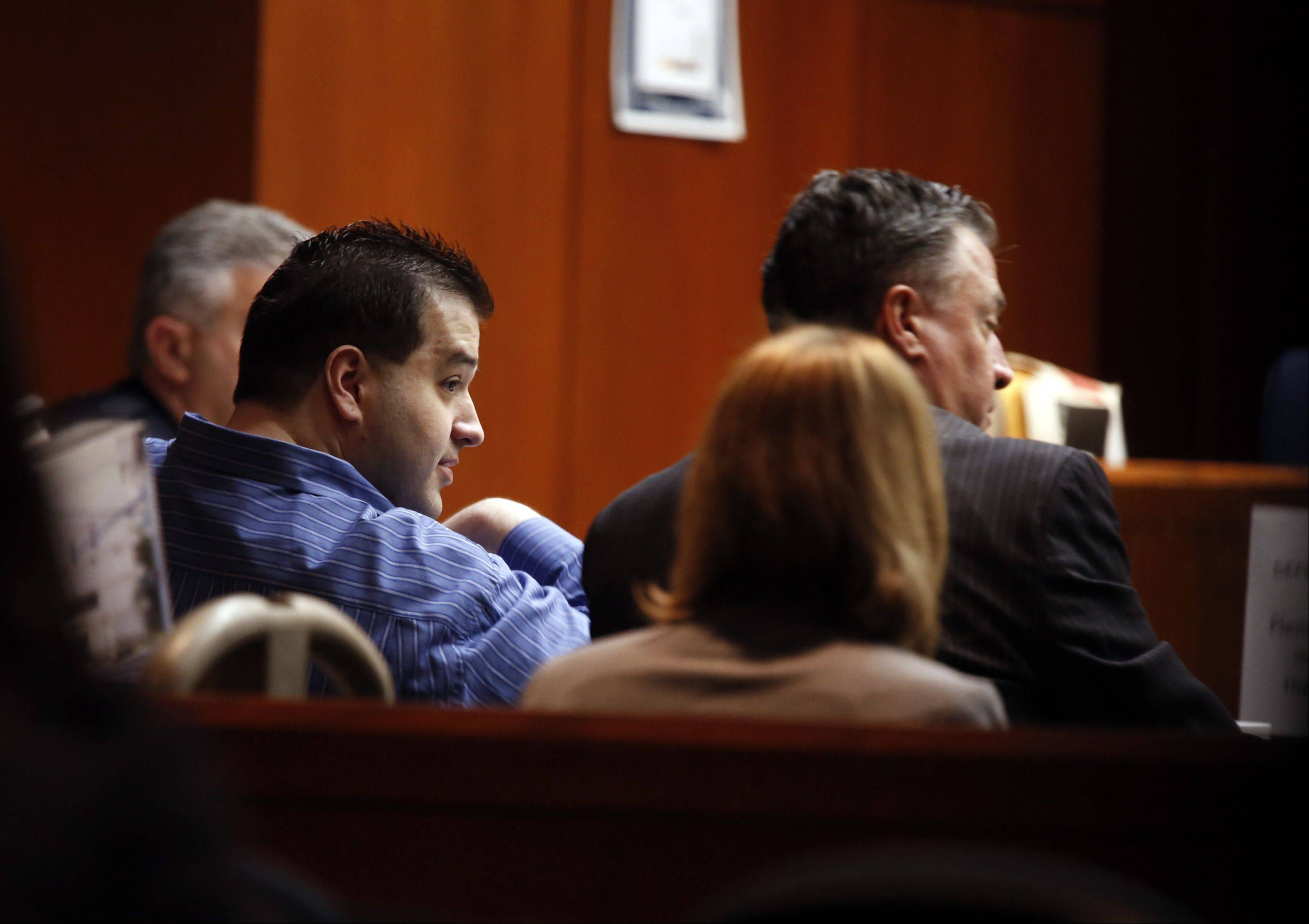 POOL/Chicago Tribune, Chuck BermanDefendant Johnny Borizov, left, who is being tried on charges of first-degree murder and solicitation of murder, sits at the defense table Wednesday at the DuPage County courthouse in Wheaton.