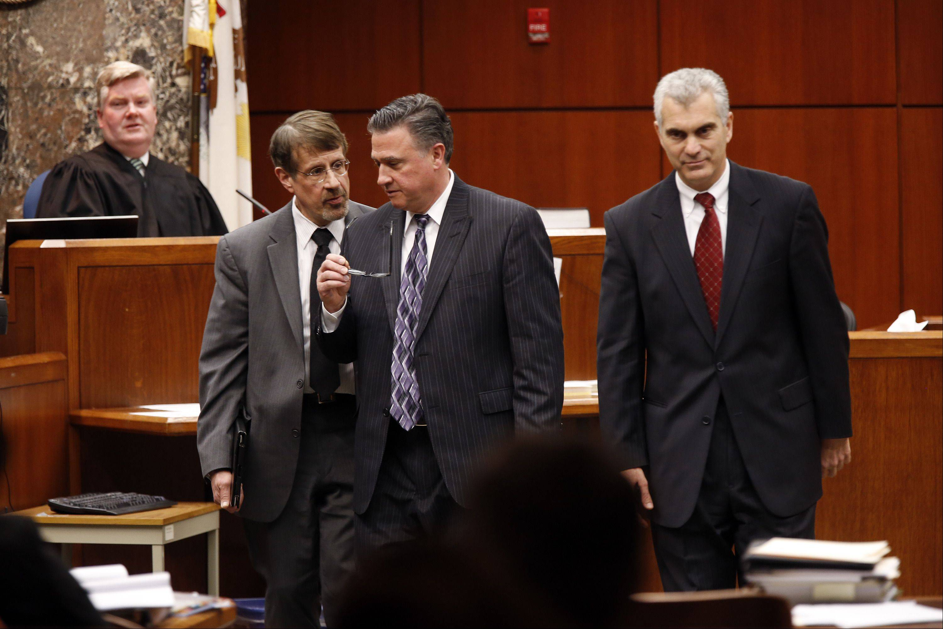 POOL/Chicago Tribune, Chuck BermanDefense attorneys Richard Kling, from left and Paul DeLuca and DuPage County Assistant State's Attorney Joe Ruggiero head back to their seats after a sidebar with Judge Daniel Guerin, rear, Wednesday in Wheaton.