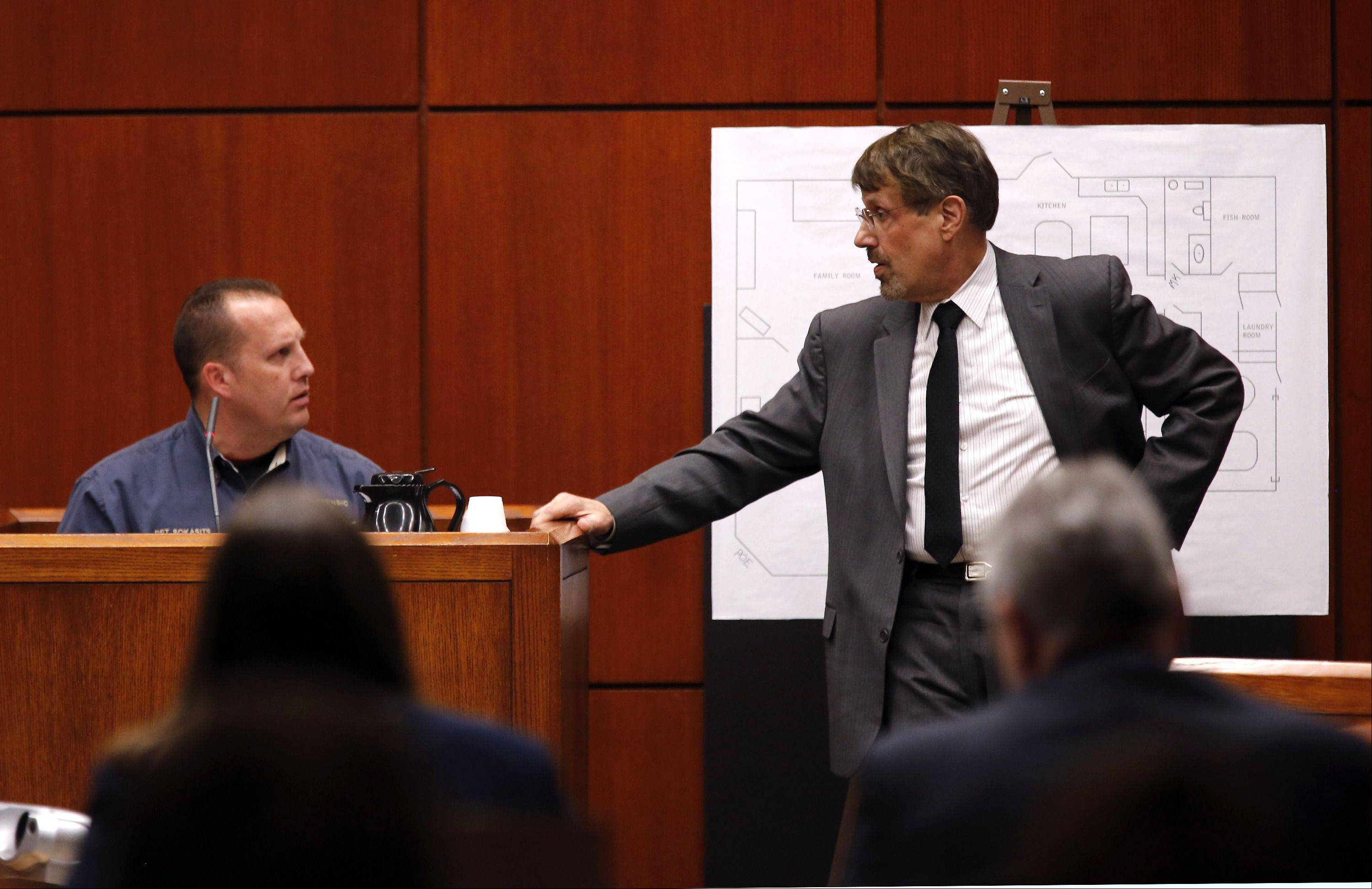POOL/Chicago Tribune, Chuck BermanDuPage County sheriff's police detective Edward Sokasits, left, is questioned by defense attorney Richard Kling on Wednesday during the trial of Johnny Borizov at the DuPage County courthouse.