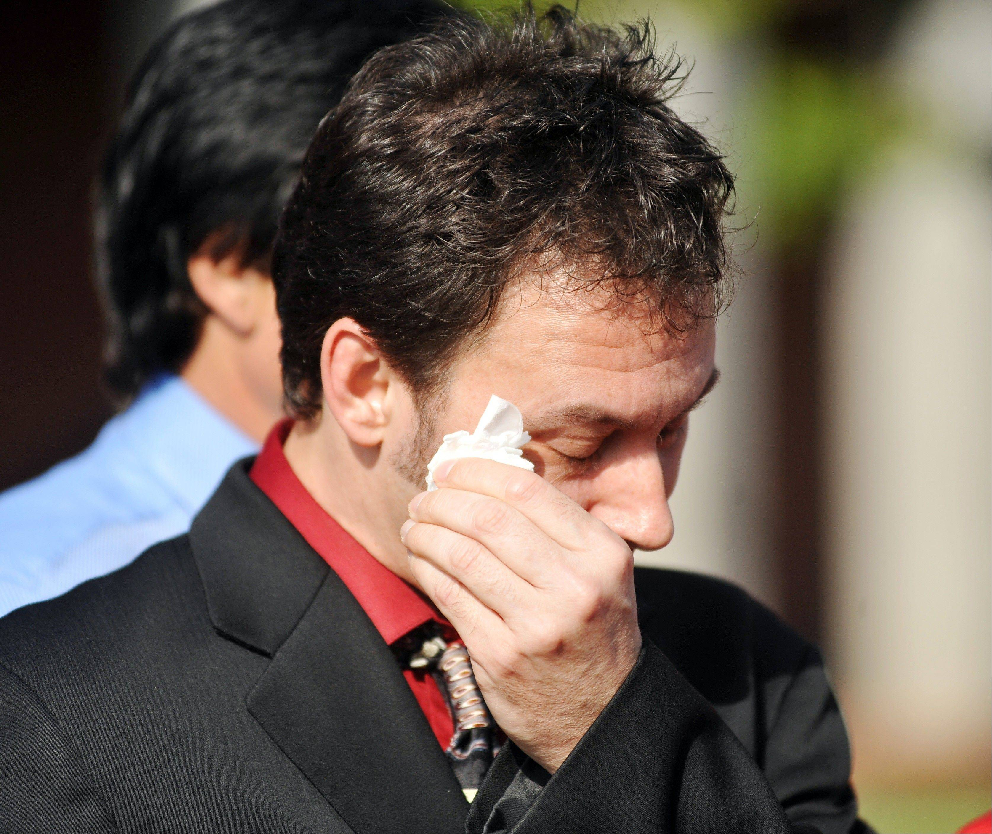 Paul Kevin Curtis, who had been in custody under suspicion of sending ricin-laced letters to President Barack Obama and others, wipes a tear from his eyes during a news conference following his release Tuesday, April 23, 2013 in Oxford, Miss. The charges were dismissed without prejudice, which means they could be reinstated if prosecutors so choose.