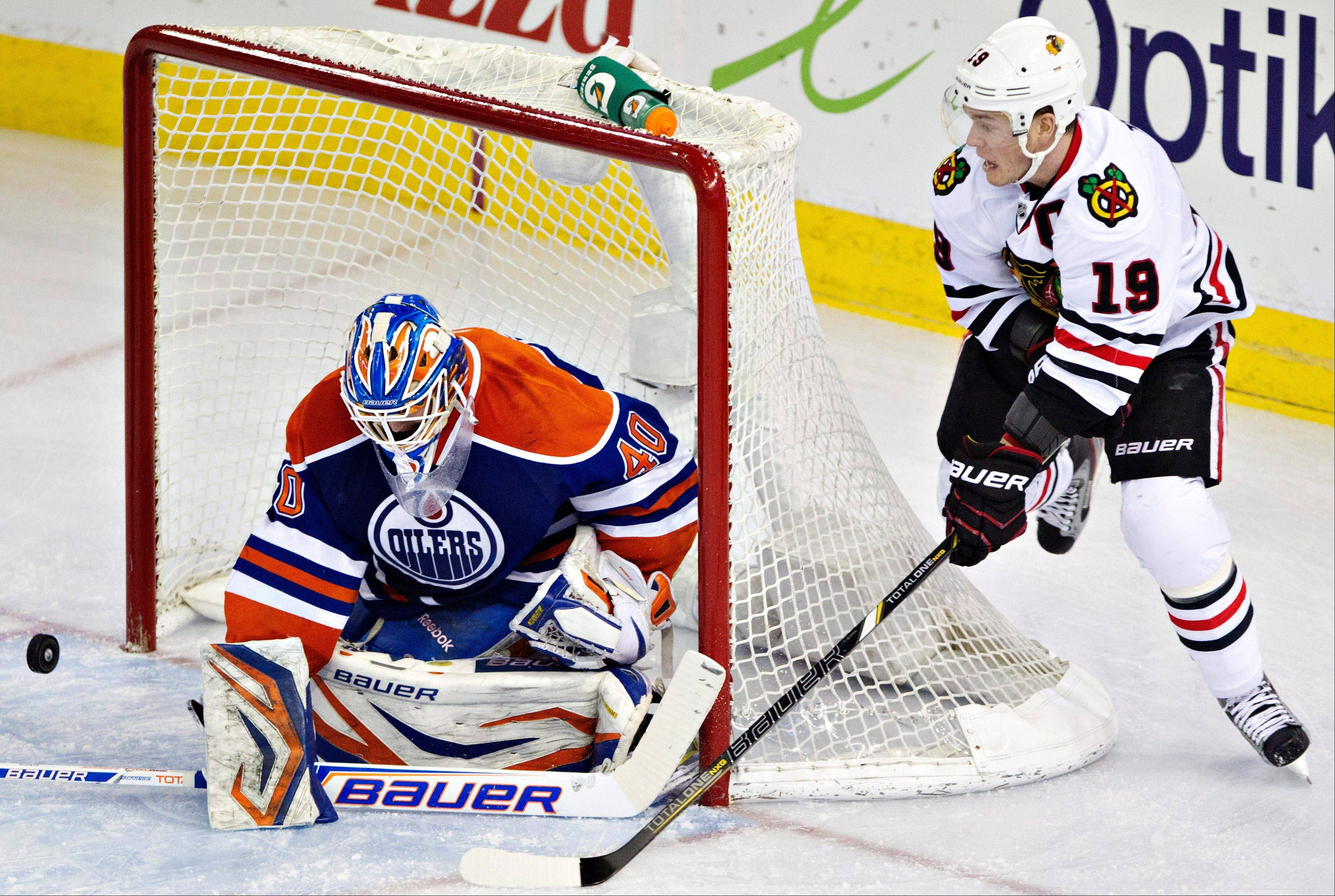 Jonathan Toews is stopped by Edmonton Oilers goalie Devan Dubnyk Wednesday night in Edmonton.