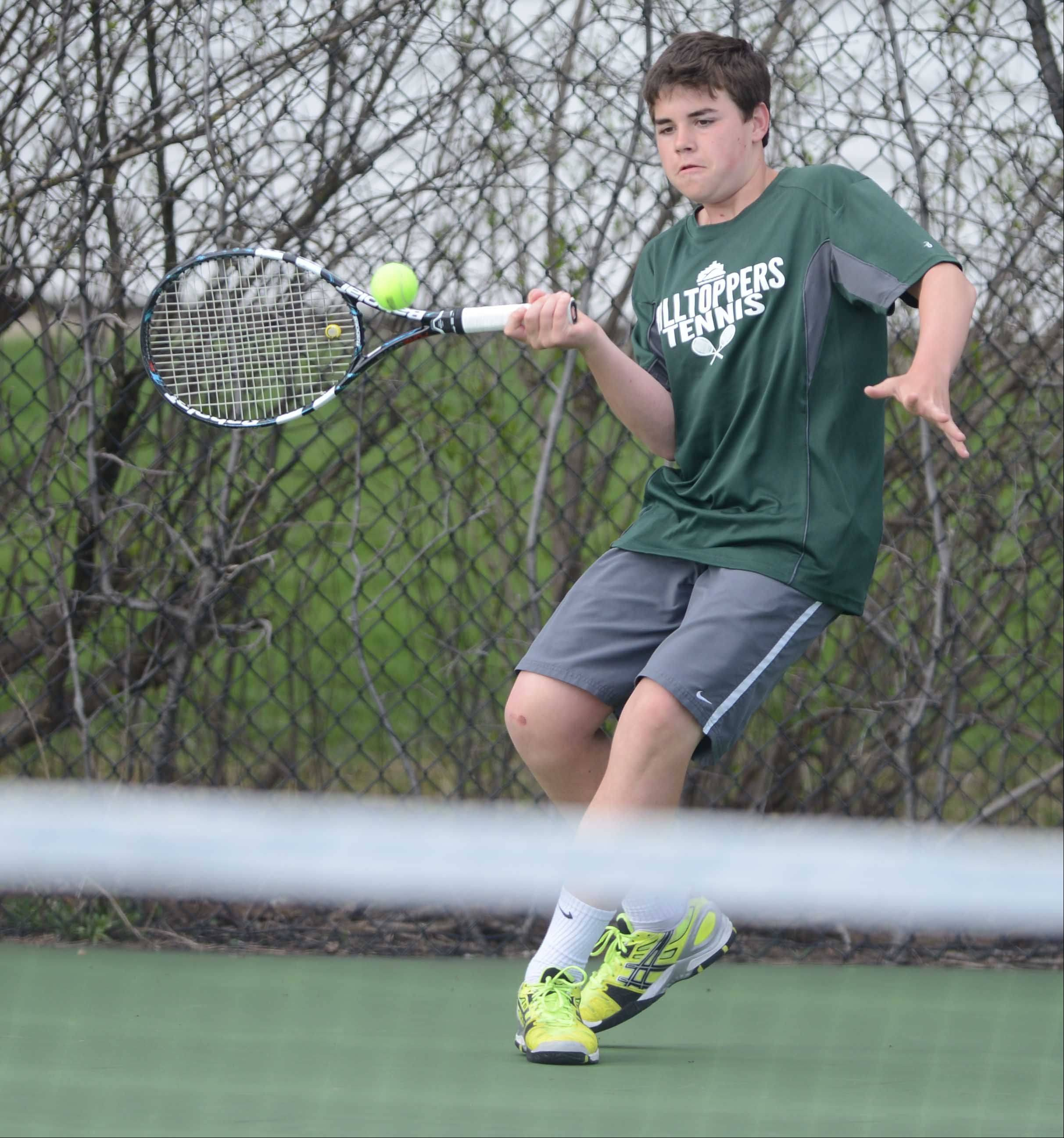 Nate Dell of Glenbard West in the #1 singles match during the Glenbard West at Wheaton North boys tennis meet Wednesday.