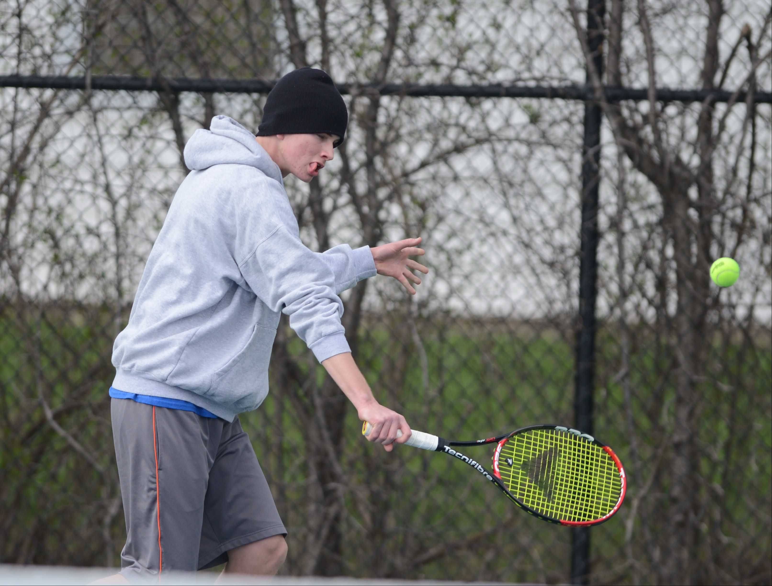 Brent Westergren of Wheaton North in the #1 singles match during the Glenbard West at Wheaton North boys tennis meet Wednesday.