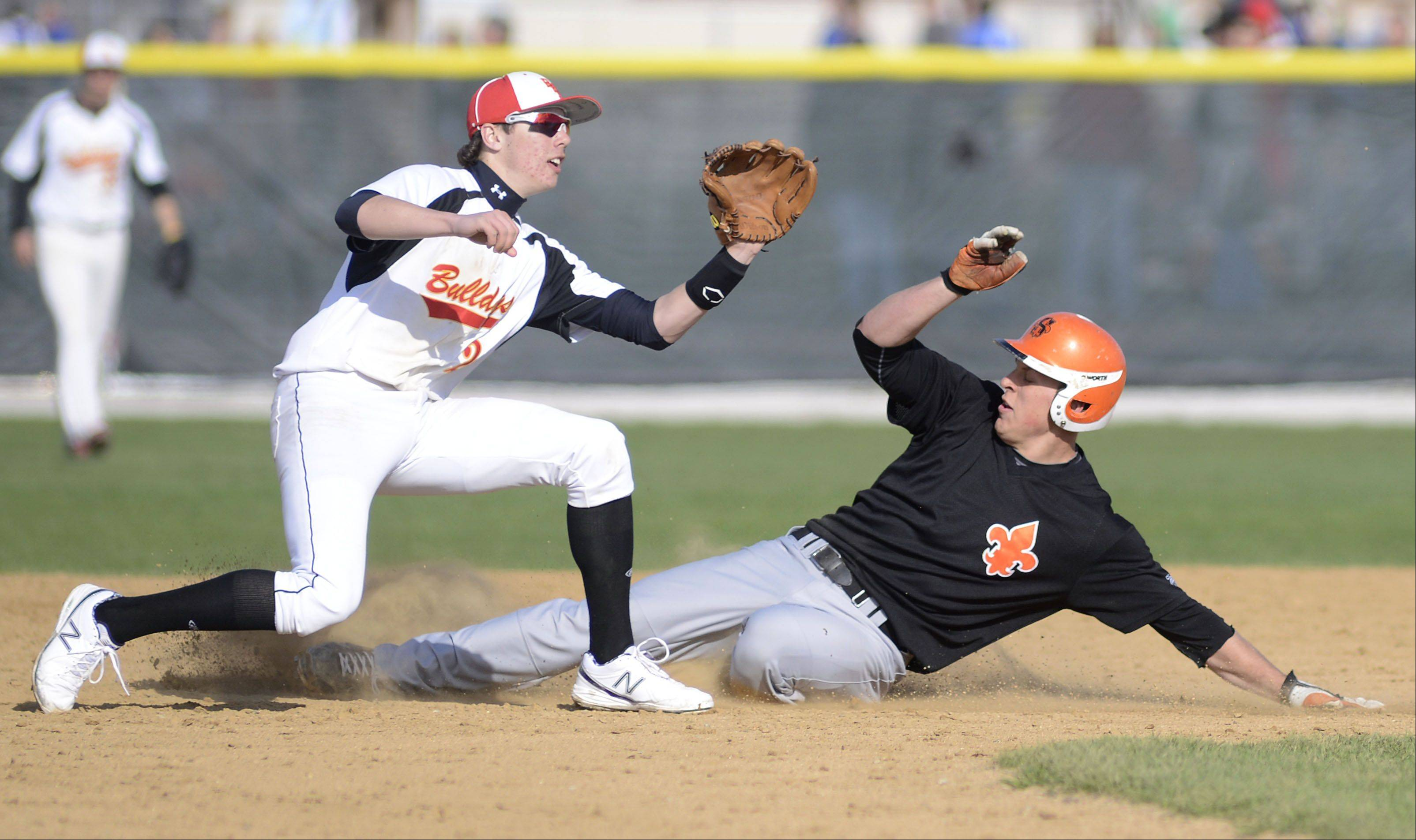 St. Charles East's Joe Hoscheit is safe on second base from Batavia's Jeremy Schoessling in the third inning on Wednesday, April 24.