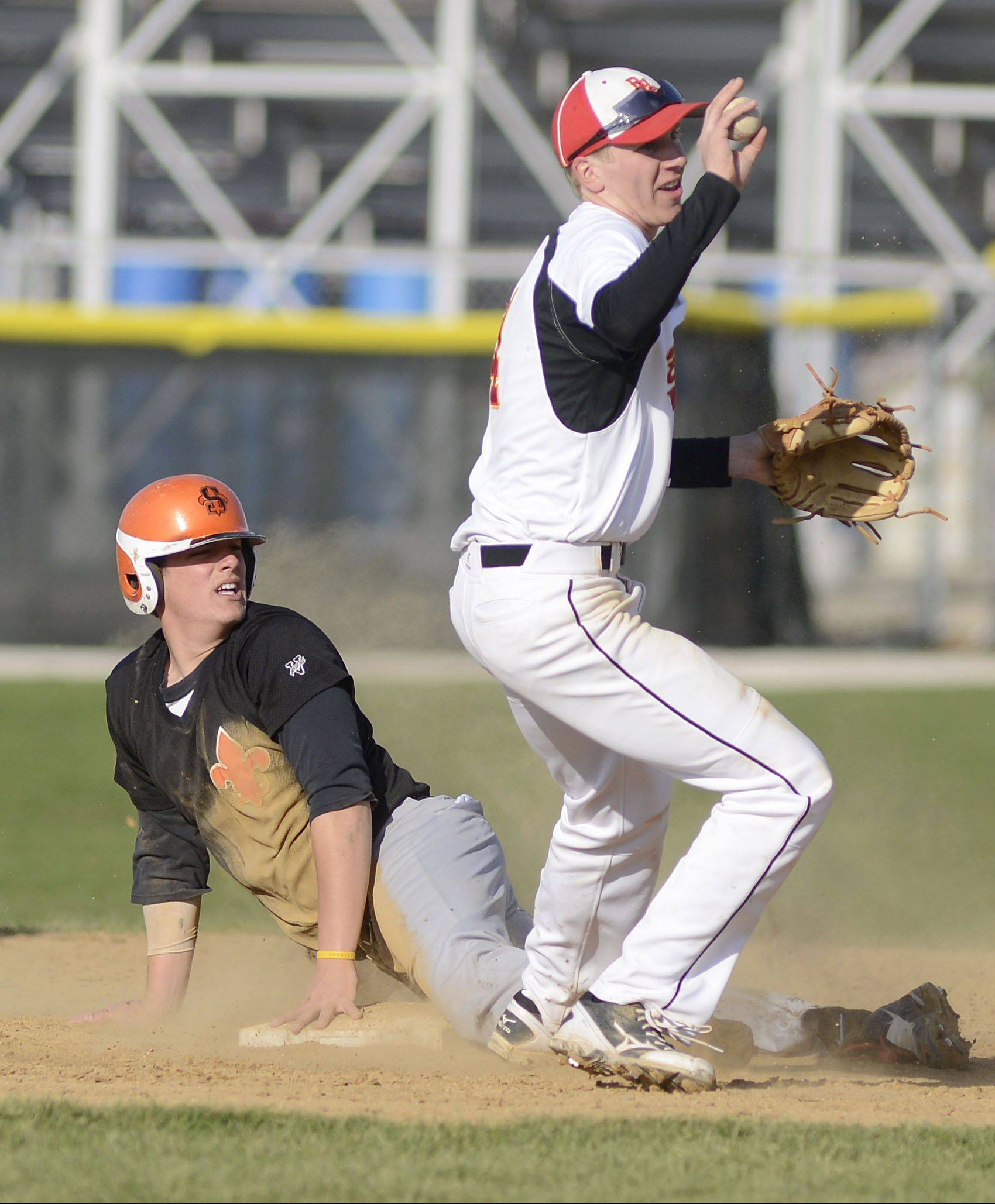 Batavia's Billy Zwick shows he has the ball after tagging St. Charles East's Anthony Sciarrino out at second base Wednesday.