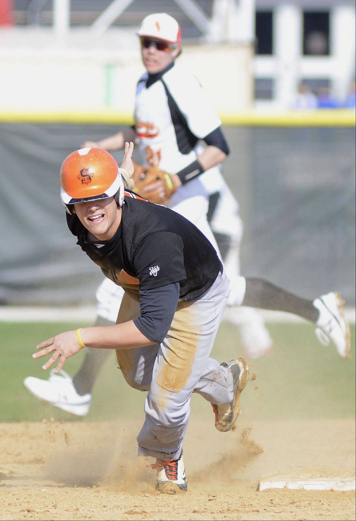 St. Charles East's Anthony Sciarrino picks himself up after sliding into second base and heads for third in the second inning on Wednesday, April 24.