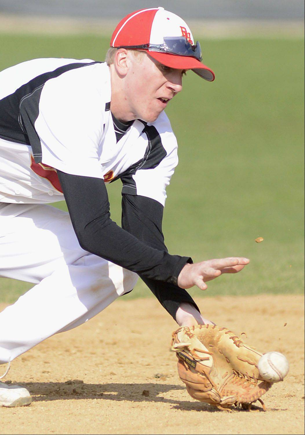Batavia's Billy Zwick grabs a ground ball and sends it to first base in the second inning on Wednesday, April 24.