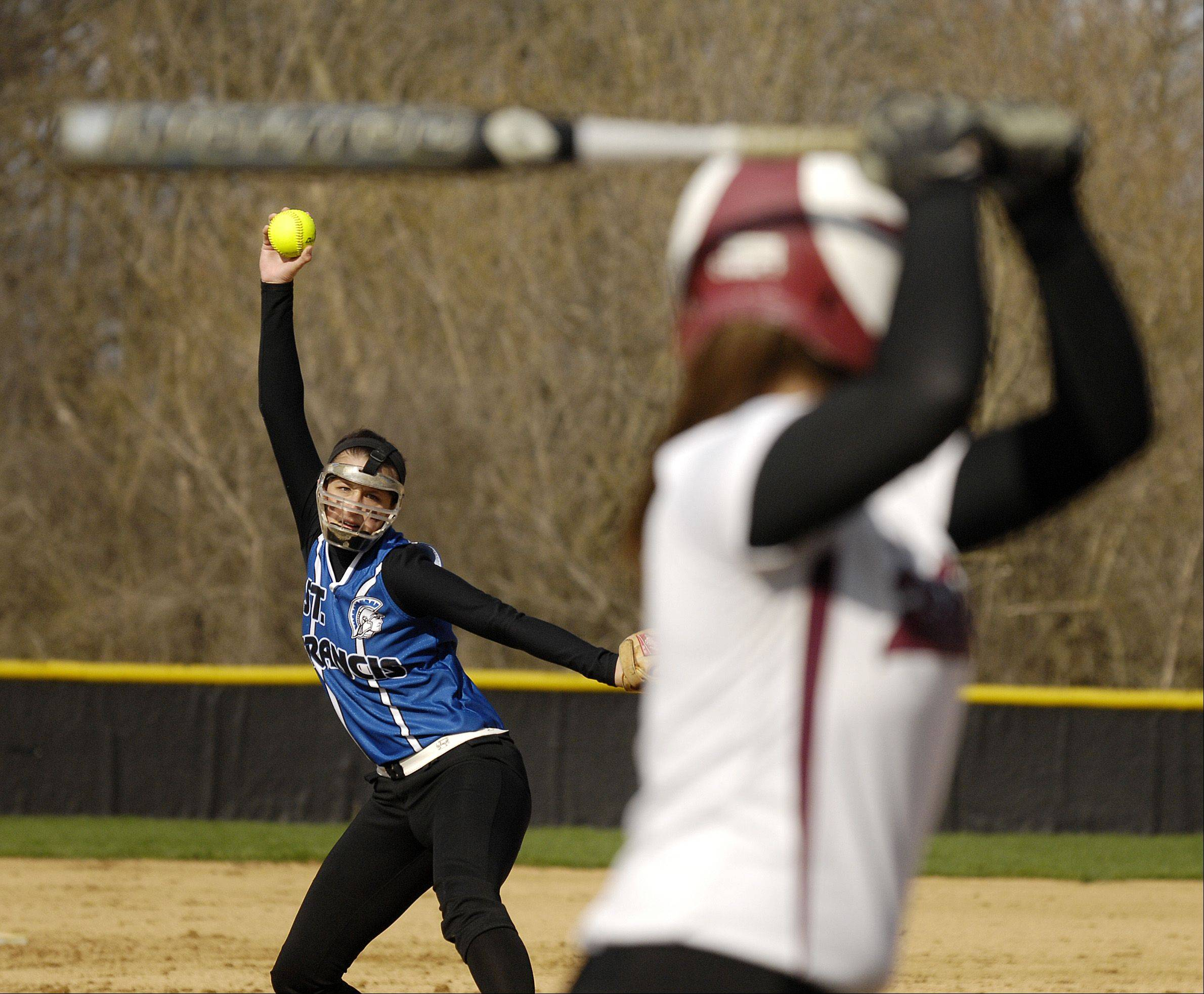 Maggie Remus of St. Francis pitches against Gina Graff of Wheaton Academy in West Chicago, Wednesday.