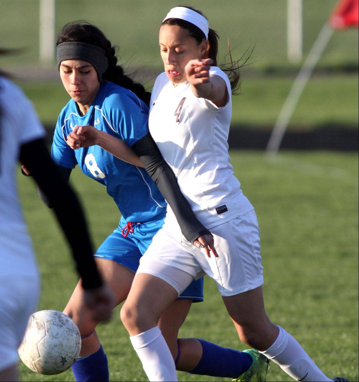 Larkin's Berenice Gomez, left, and Elgin's Gaby Delgado pursue the ball at Memorial Field in Elgin on Wednesday evening.